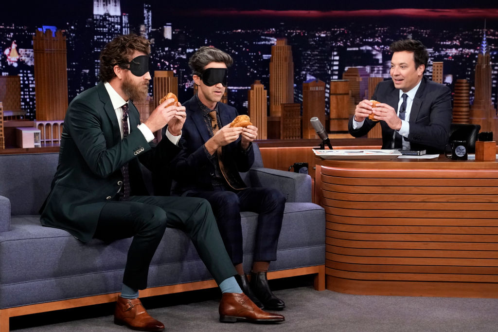 Comedians Rhett & Link try the Popeye's chicken sandwich during their interview with host Jimmy Fallon on October 29, 2019.