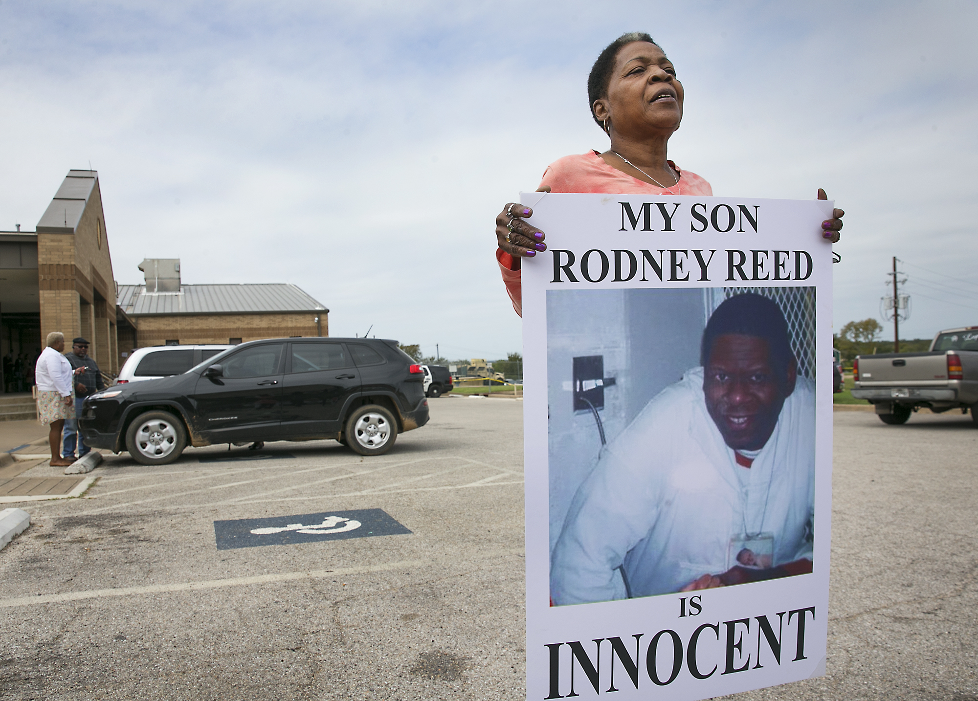 Sandra Reed, the mother of death row inmate Rodney Reed, shows her continued support of her son by carrying this placard around the parking lot during a break in a hearing in Bastrop County District Court on Tuesday, October 10. 2017.