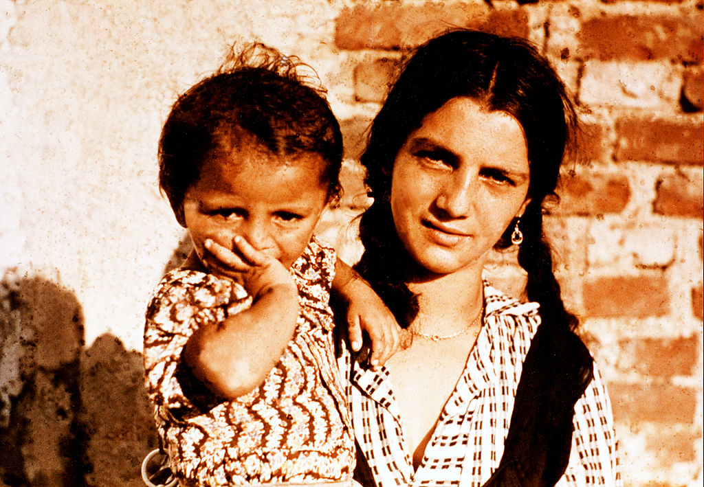 A young Roma woman with child in a camp during an investigation conducted by the Racial Hygiene Research Centre at the Reich Bureau for Health.