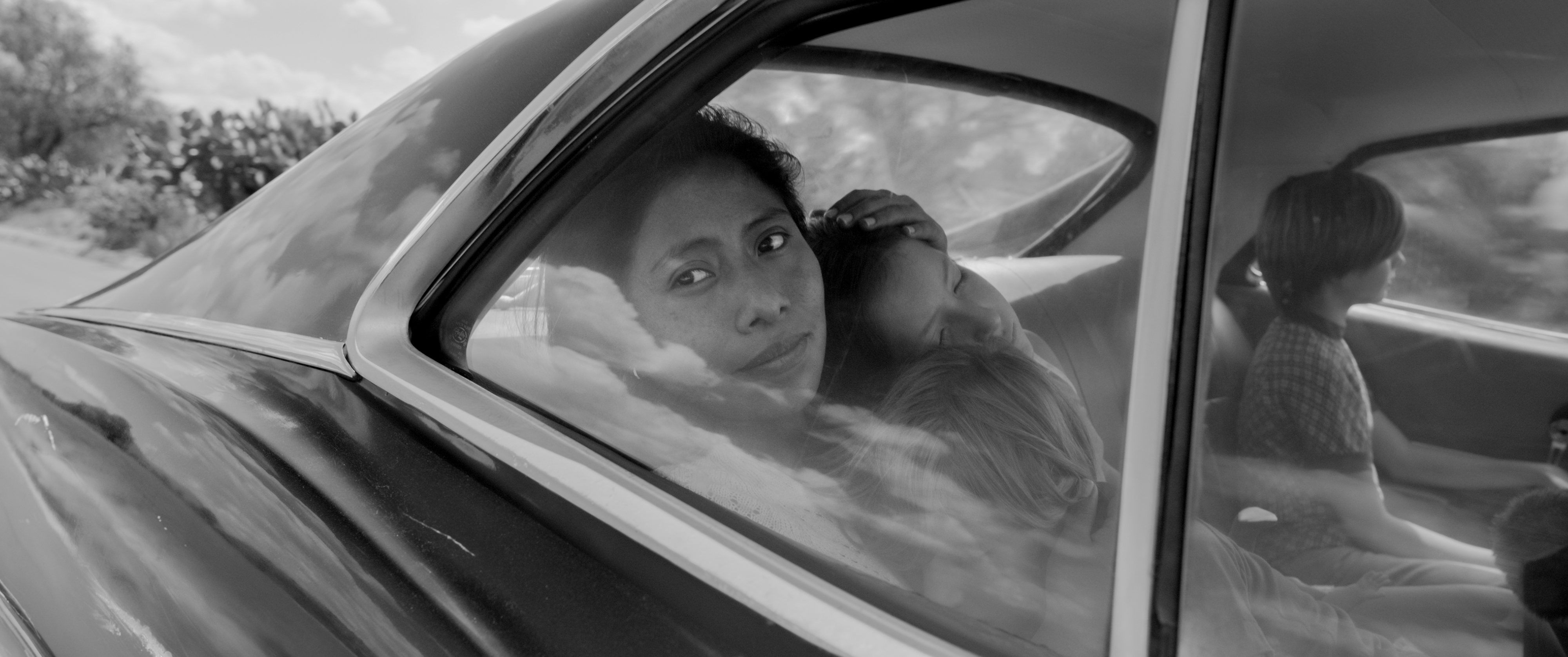 Yalitza Aparicio (left) as Cleo in Roma.