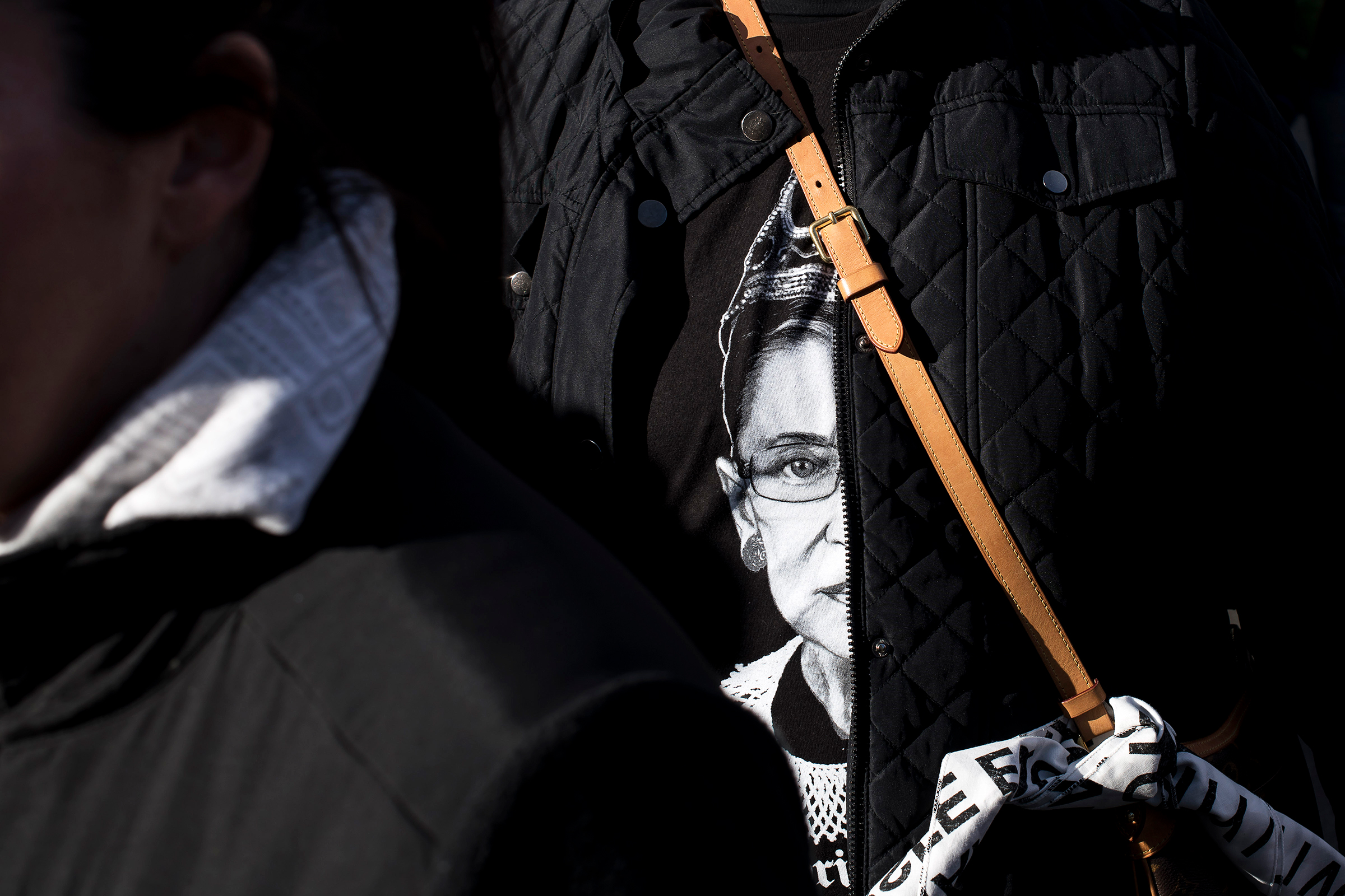 A woman attending the New York City Women's March wears a t-shirt featuring Supreme Court Justice Ruth Bader Ginsburg on Jan. 20, 2018.