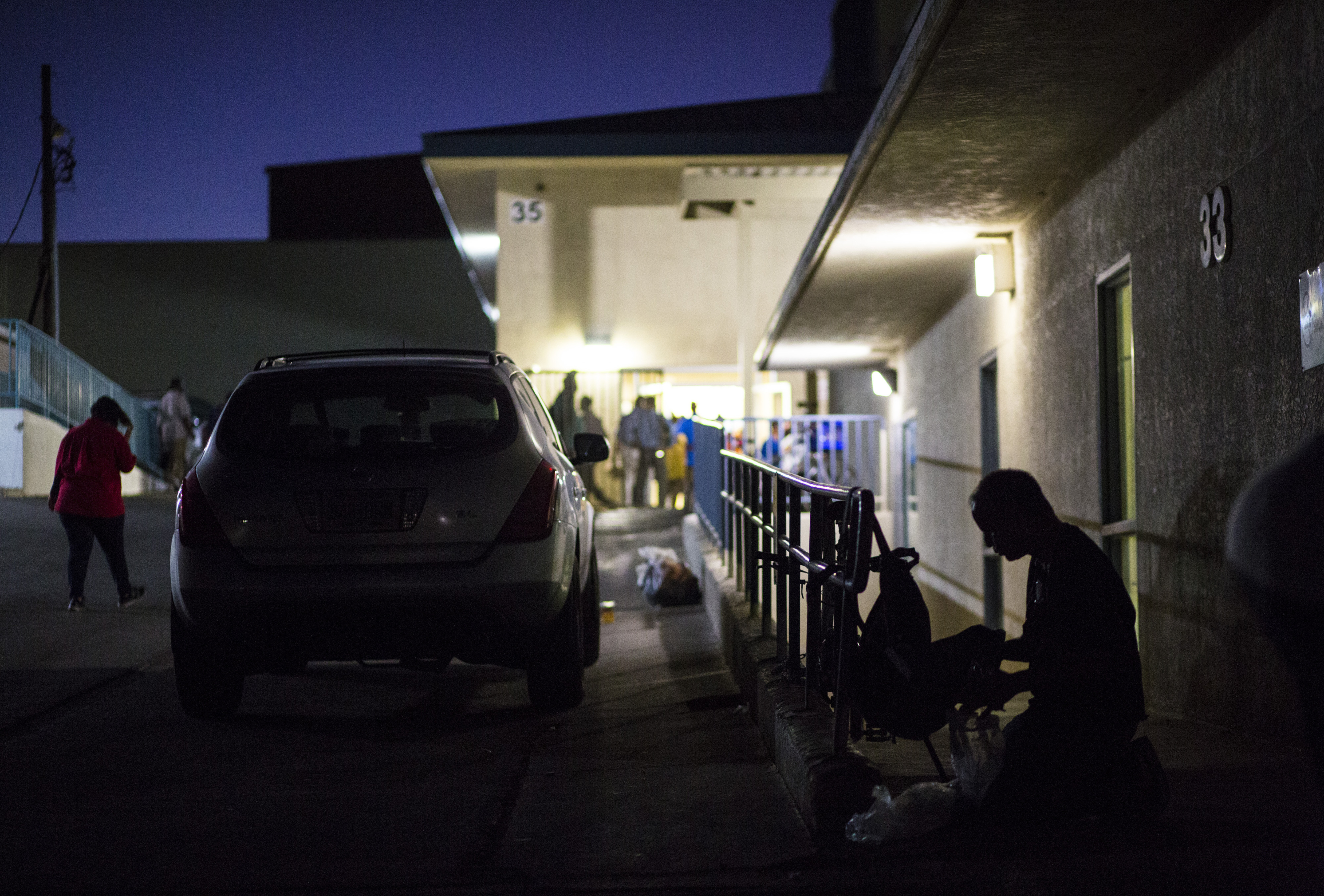 This Oct. 15, 2019, file photo shows a patron of The Salvation Army homeless shelter, right, checking his belongings at a shelter near downtown Las Vegas.