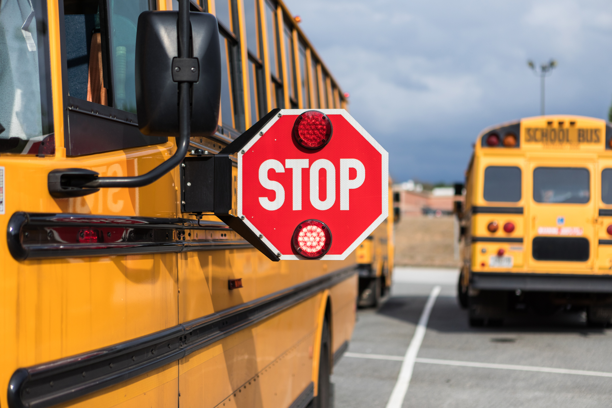 A school bus driver checks multiple aspects of the bus before route. A Colorado school district announced that it would close all of its schools on Nov. 21 and Nov. 22.