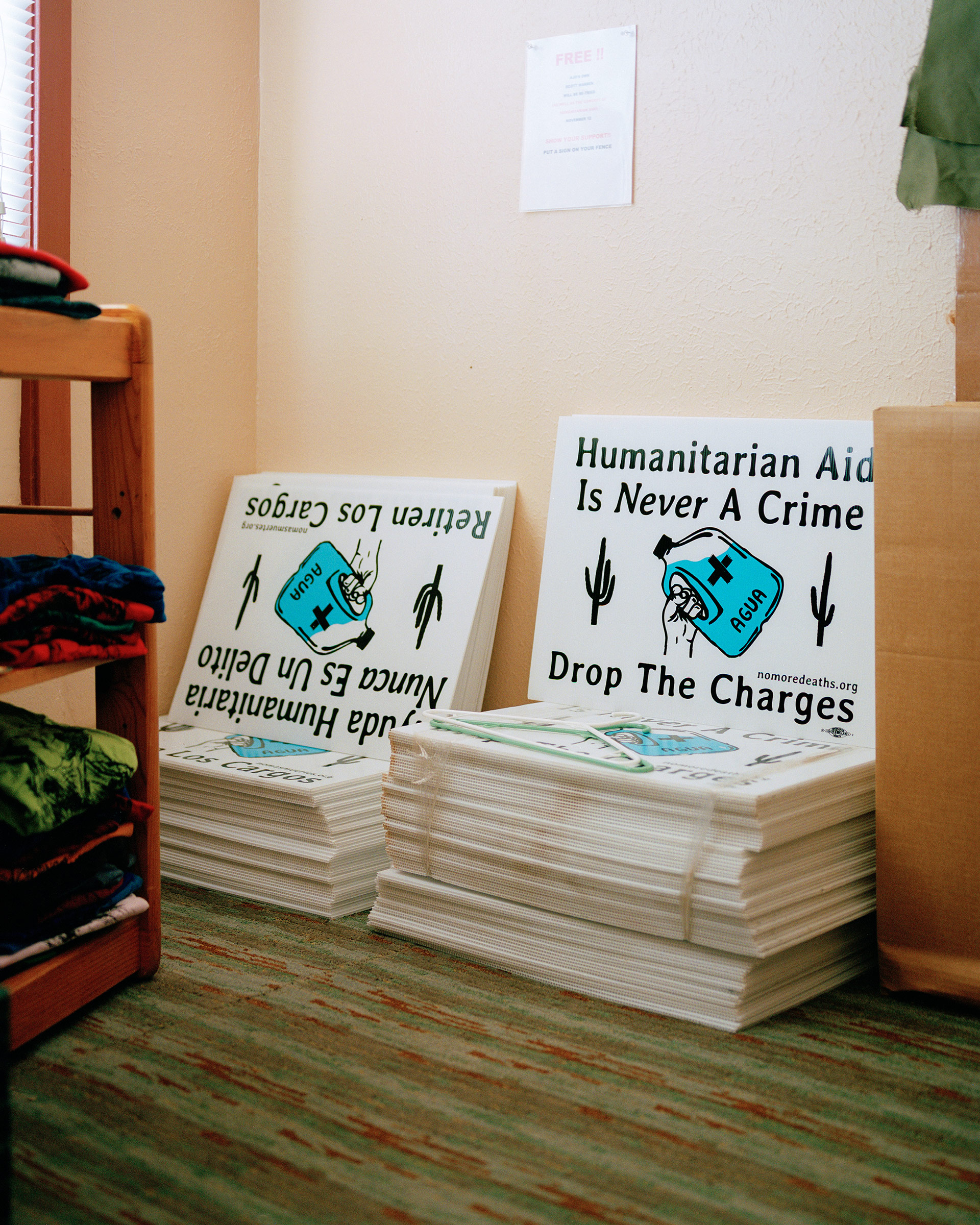 Signs in support of Warren that are available for businesses and homes sit in the Ajo Humanitarian Aid Office on Sept. 17.