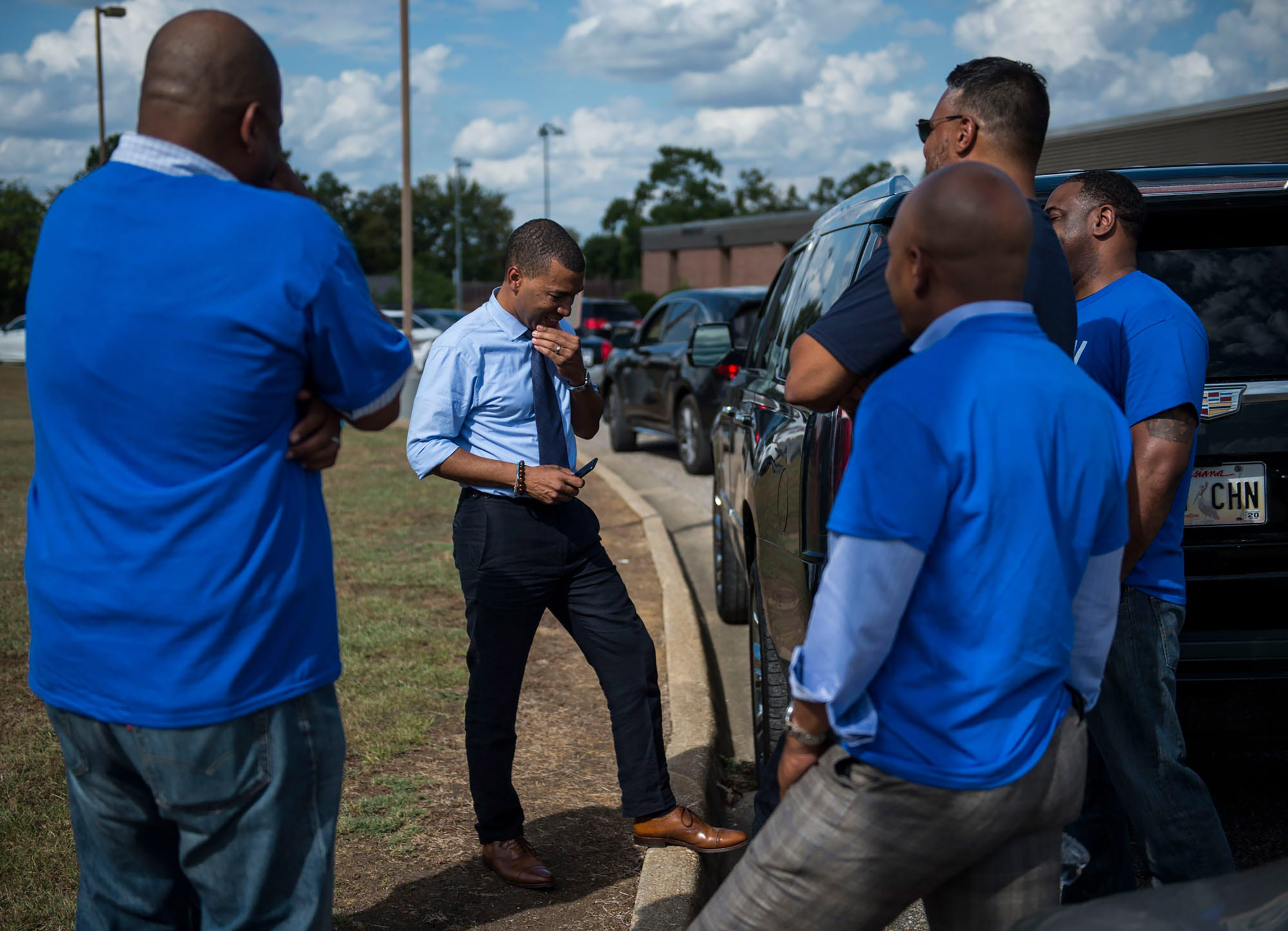 Mayoral candidate Steven Reed talks with his team at Southlawn Elementary School in Montgomery, Ala., on Oct. 8.