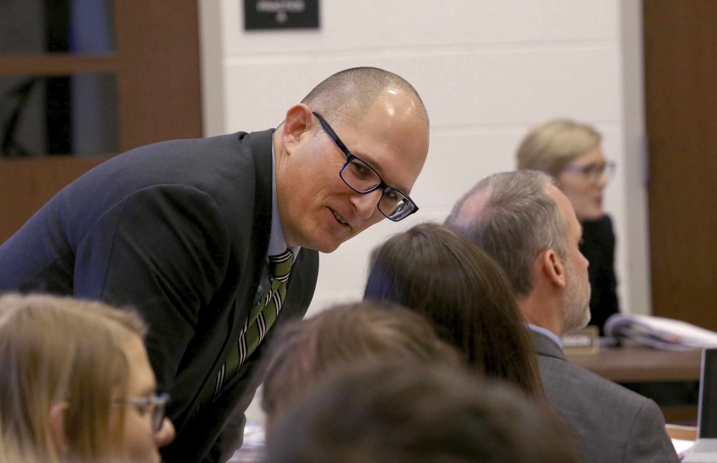 High school teacher Peter Vlaming chats at a West Point School Board hearing in West Point, Virginia on Dec. 6, 2018.