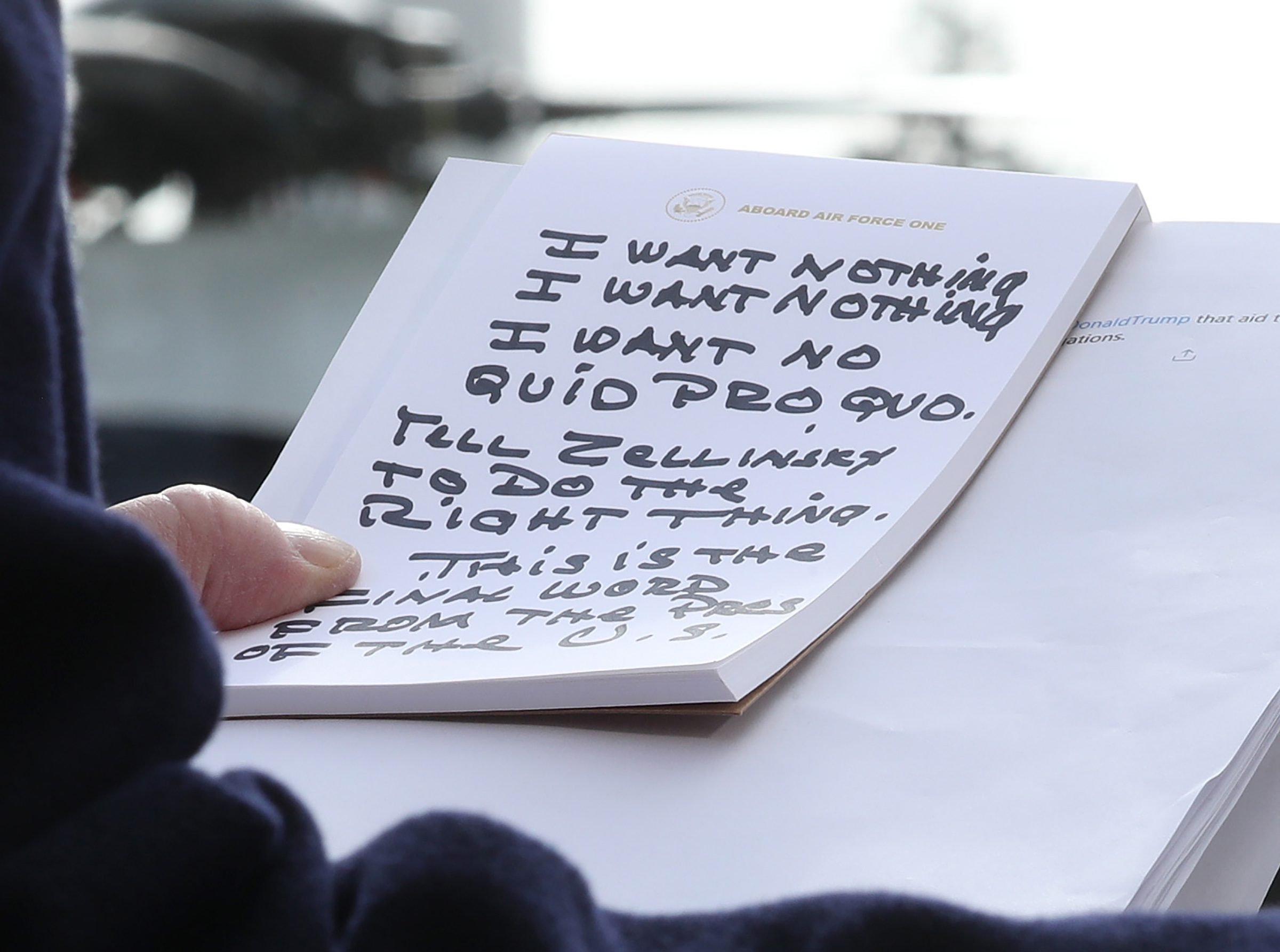 U.S. President Donald Trump holds his notes while speaking to the media before departing from the White House in Washington D.C. on Nov. 20, 2019.
