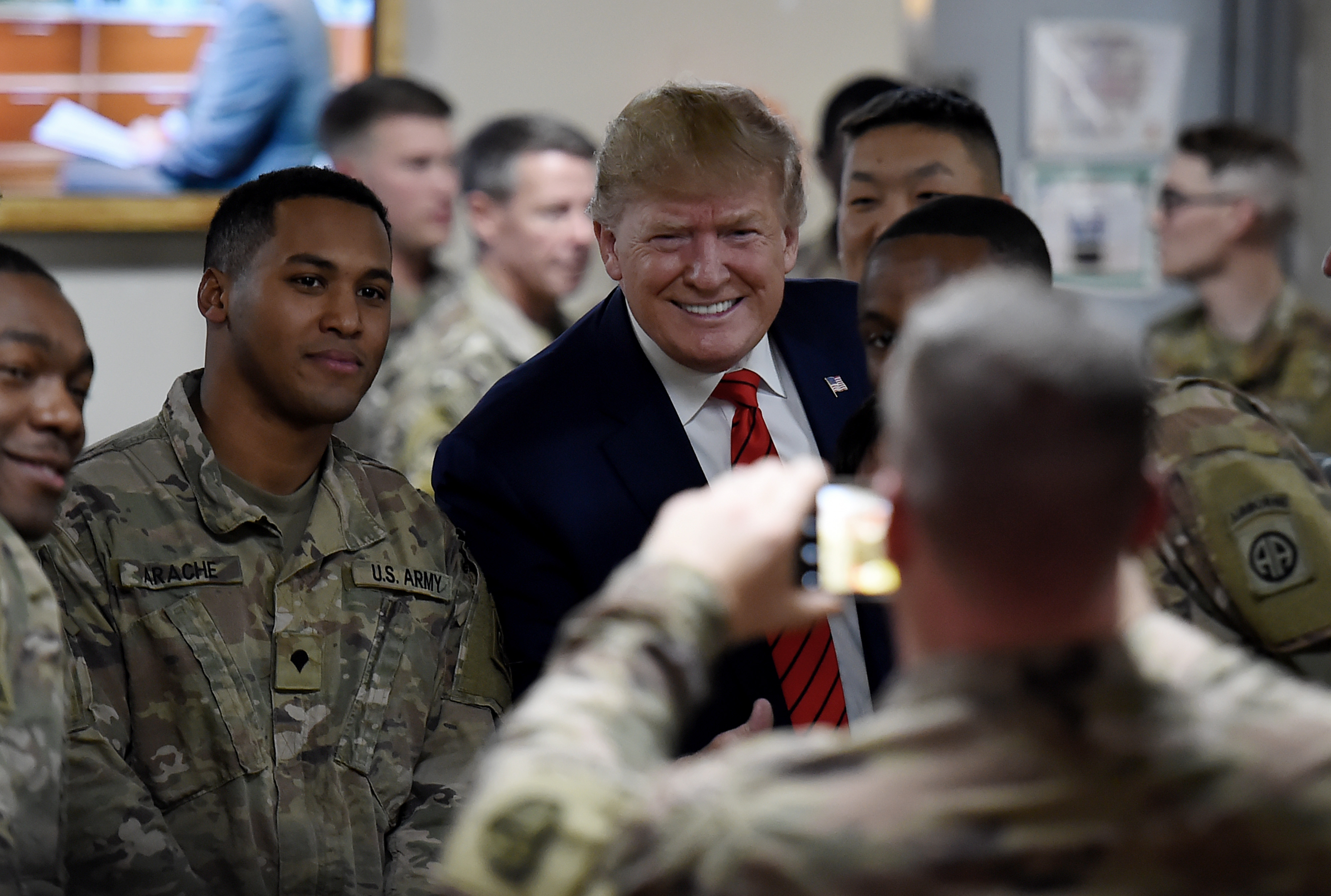 President Donald Trump poses for photos with U.S. troops at Bagram Air Field during a surprise visit on Nov. 28, 2019 in Afghanistan.