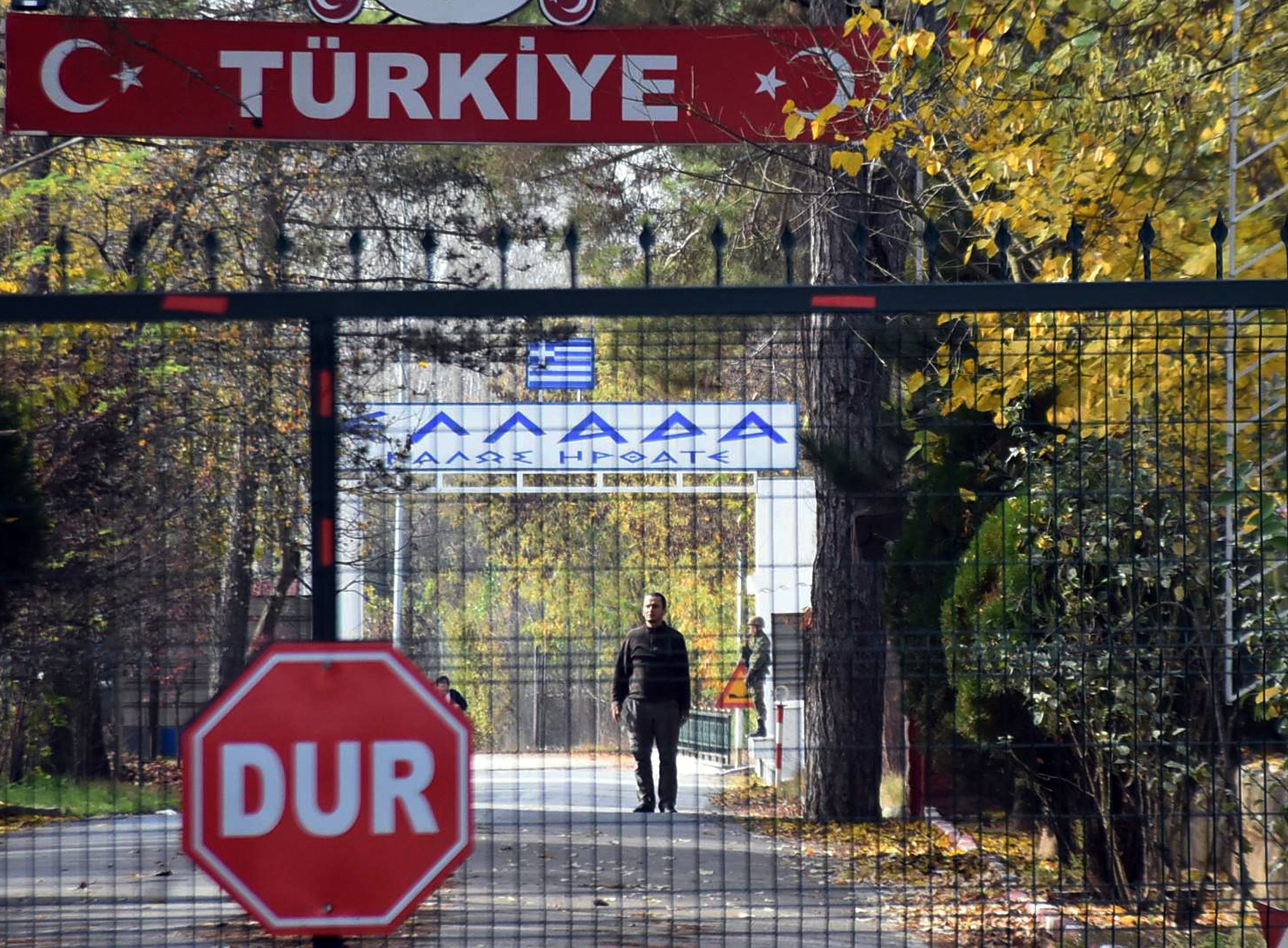 An man who is identified by Turkish news reports as a U.S. citizen who has been deported by Turkey and is now stuck in the heavily militarized no-man's land between Greece and Turkey, after Greece refused to take him in, near Pazarkule border gate, Edirne, Turkey, Monday Nov. 11, 2019.
