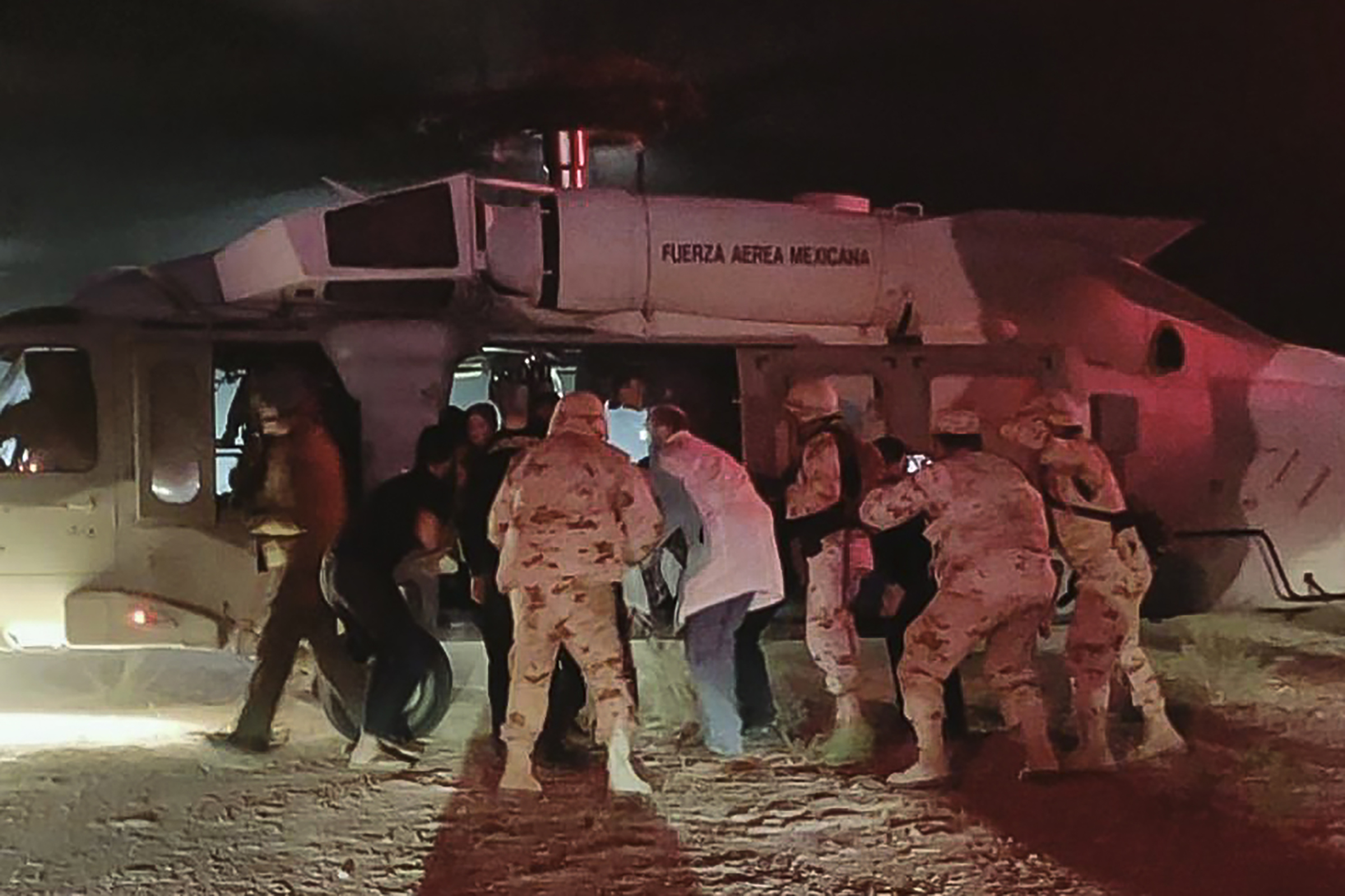 Handout picture shows Mexican Air Force medical personnel transferring five members of the Lebaron family to a hospital after being injured during an ambush between Sonora and Chihuahua in Hermosillo, Mexico, on Nov. 5, 2019.