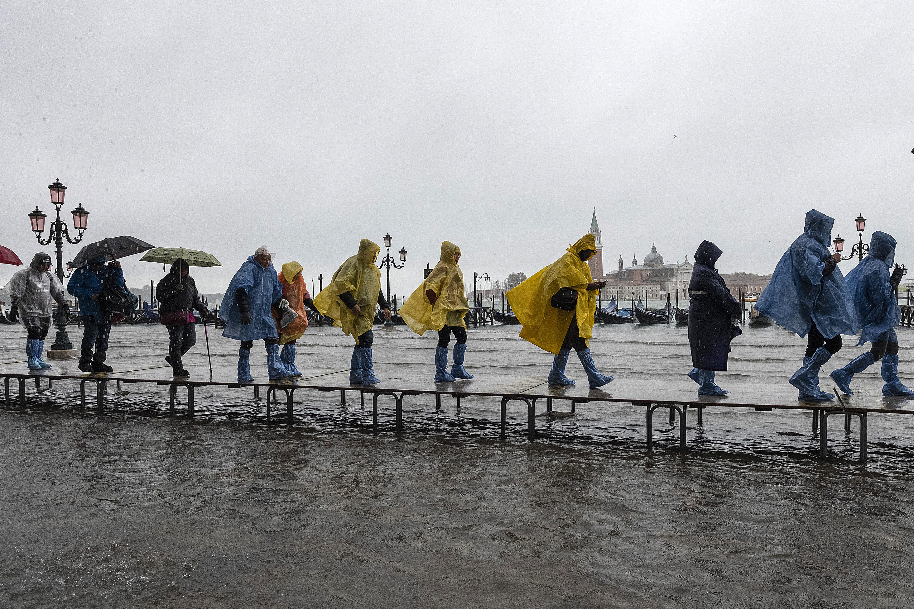 Tourists walk in high water in Piazza San Marco on Nov. 12, 2019 in Venice, Italy.
