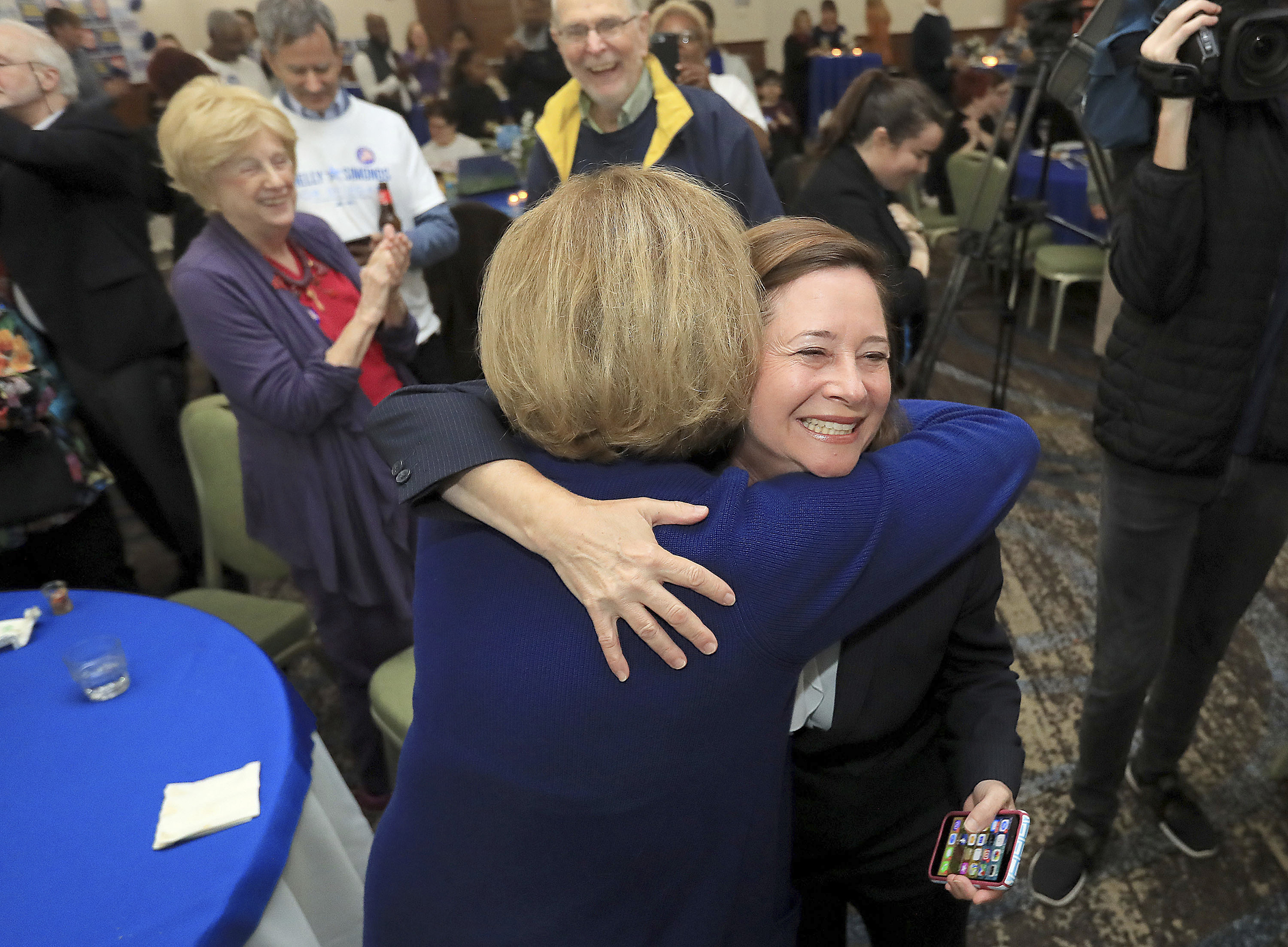 Candidate for the 94th District, Shelly Simonds, celebrates with supporters as election results begin to come in at the Marriott in Newport News, Va. on Nov. 5, 2019.