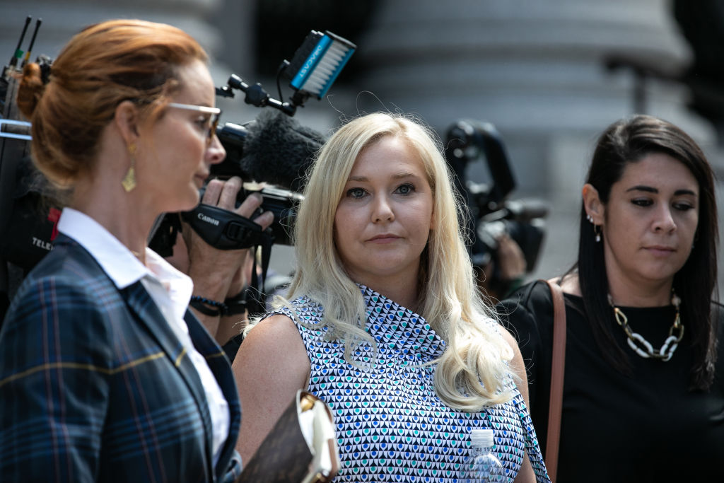 Virginia Giuffre, an alleged victim of Jeffrey Epstein, center, exits from federal court in New York, U.S., on Tuesday, Aug. 27, 2019.