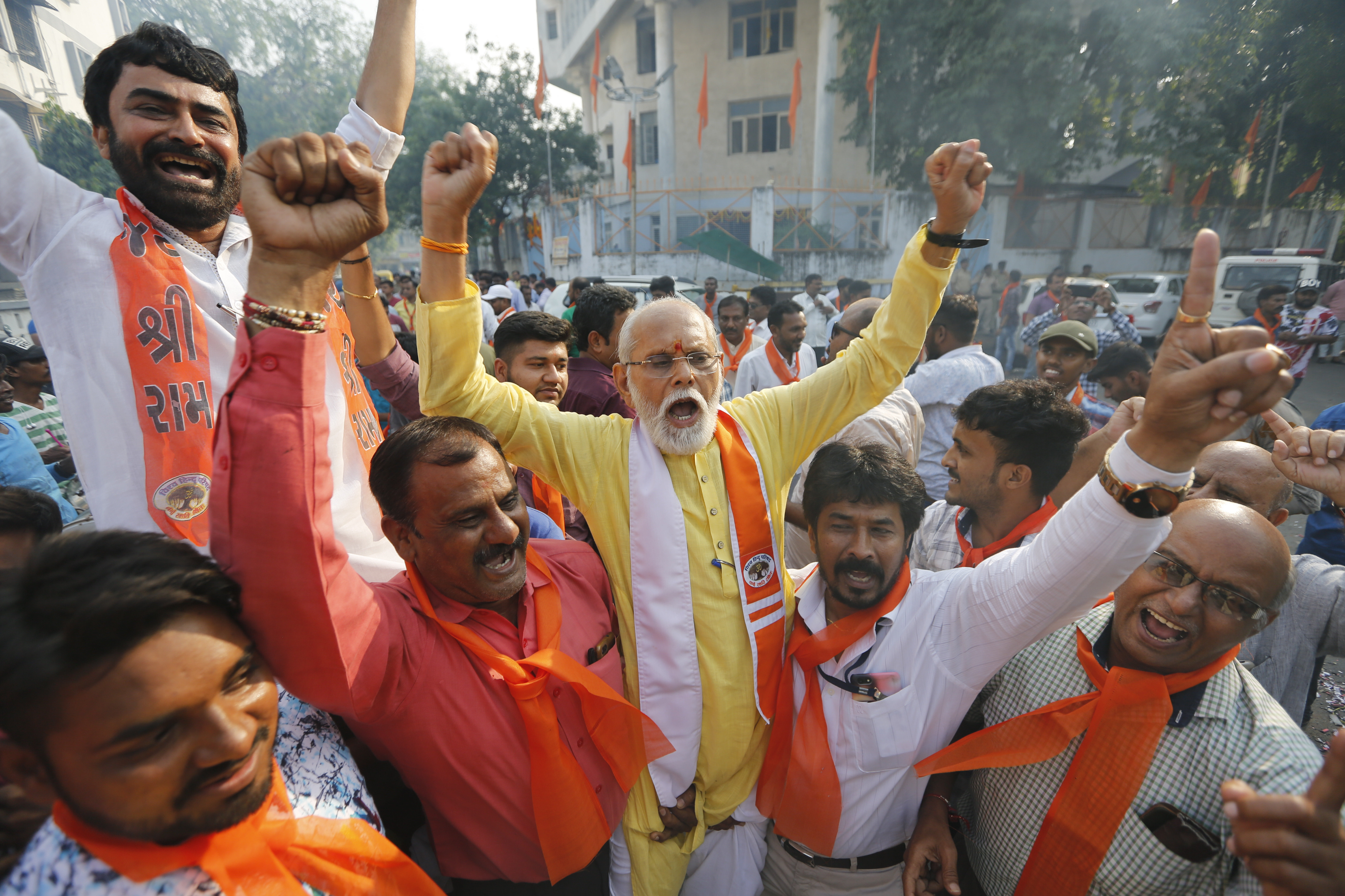Supporters of Vishwa Hindu Parishad (VHP), or World Hindu Council, celebrate the Supreme Court's verdict outside the VHP office in Ahmadabad, India, Saturday, Nov. 9, 2019.
