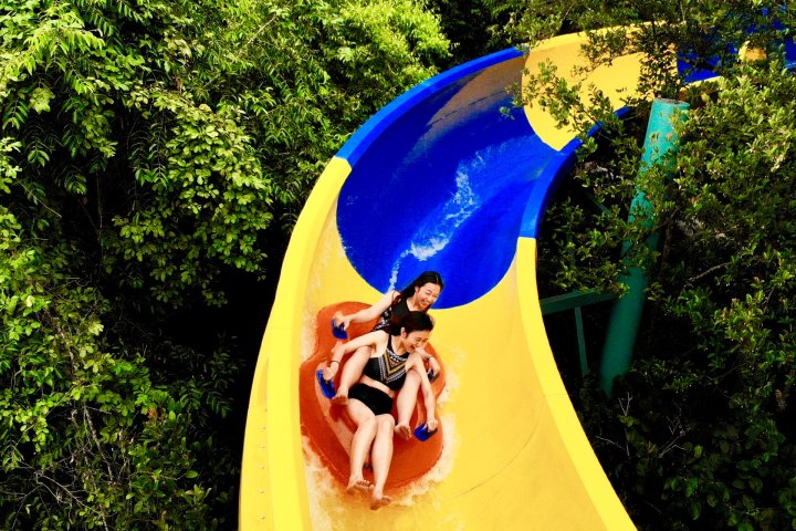 Girls riding water slide at Escape theme park in Malaysia