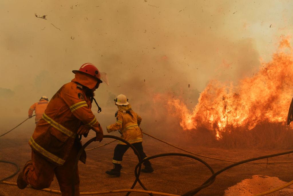 RFS Firefighters battle a spot fire on Nov. 13 in Hillville, Australia.
