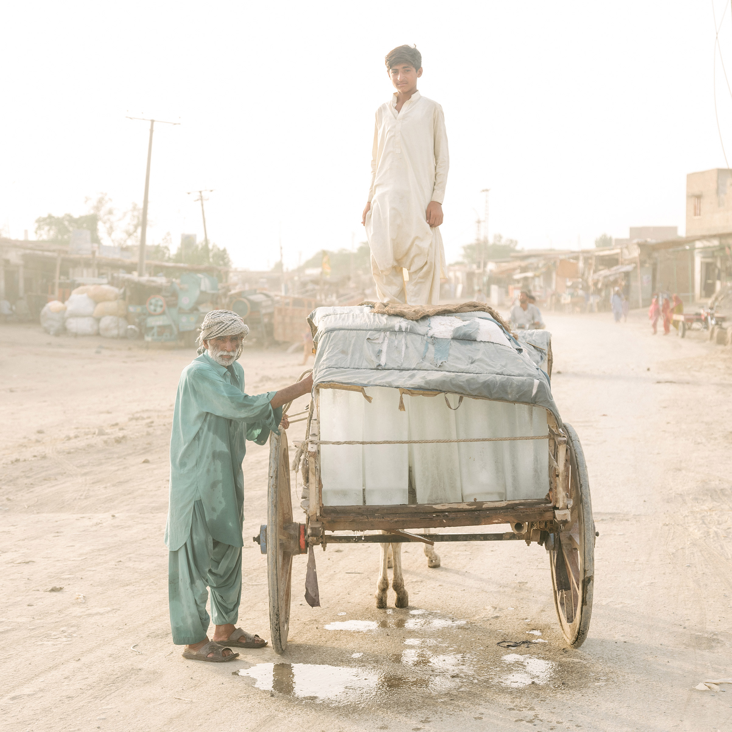 Ice sellers in Pakistan.  The Hottest City on Earth,  Sept. 23 issue.
