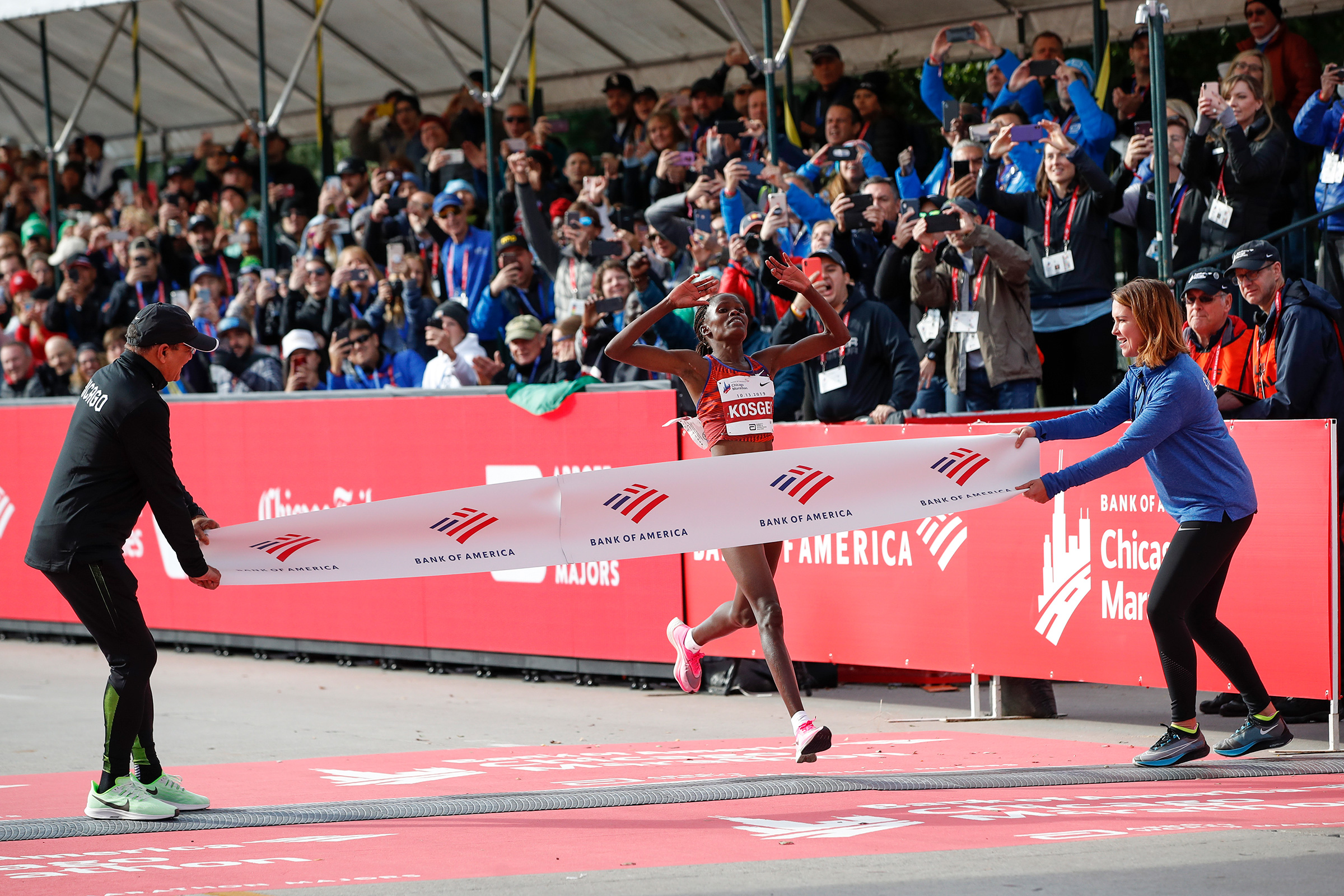 Kenya's Brigid Kosgei crosses the finish line as she wins the women's 2019 Bank of America Chicago Marathon on Oct. 13, 2019.
