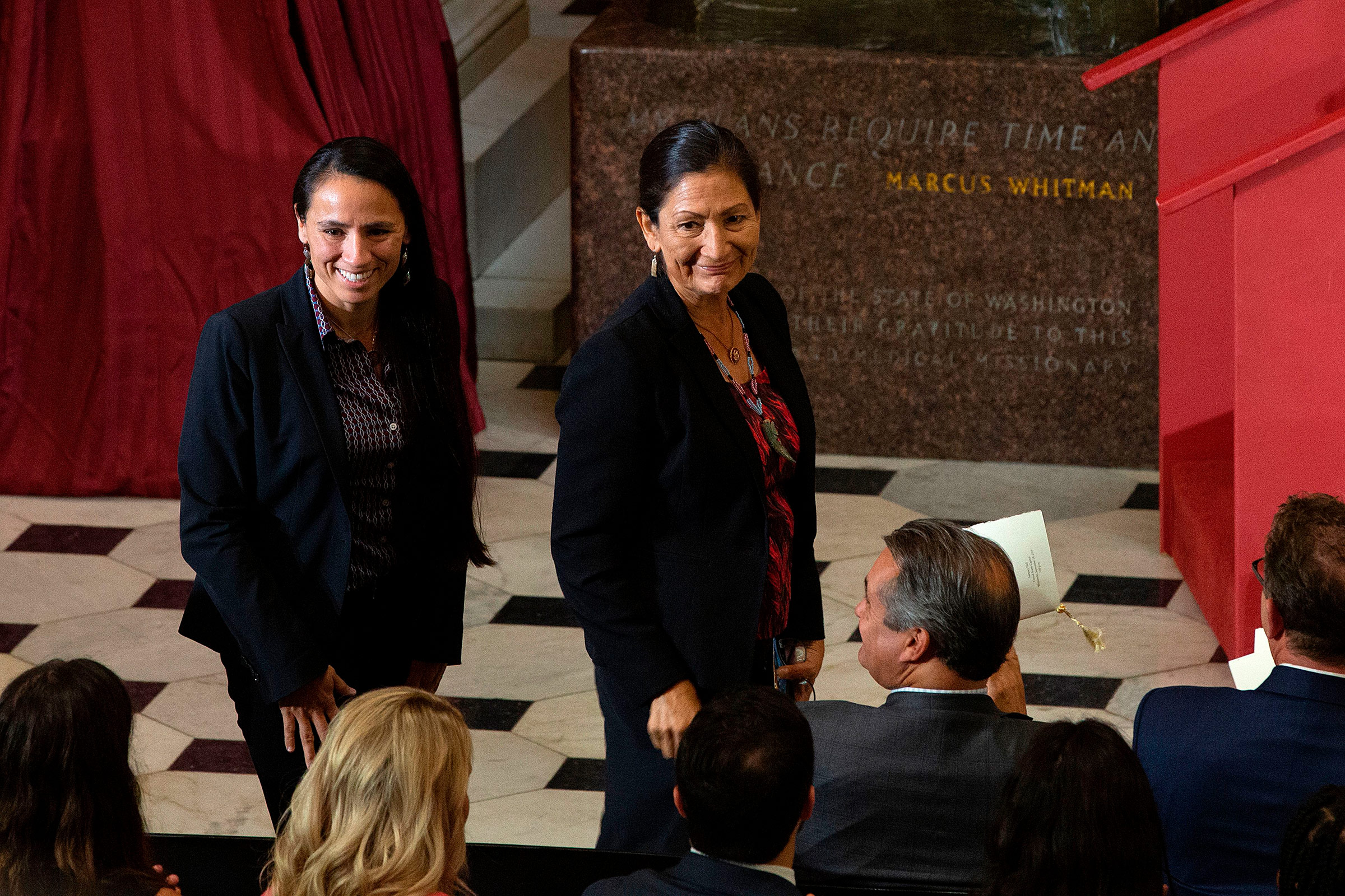 U.S. Representatives Sharice Davids, left, and Deb Haaland are recognized as the first Native American women elected to Congress during a dedication and unveiling ceremony for a statue of Ponca Chief Standing Bear of Nebraska on Capitol Hill in Washington, DC, on Sept. 18, 2019.