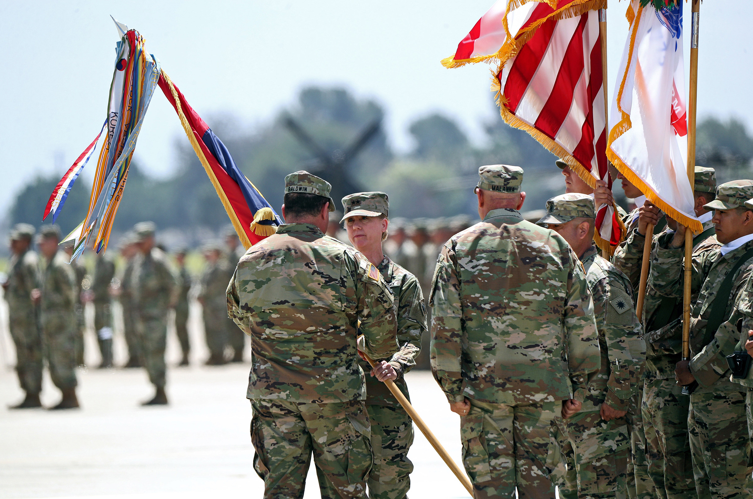 Laura L. Yeager, second from left, is joined by Adjutant General, California Military Department David S. Baldwin, left, during Change of Command Ceremony for the 40th Infantry Division, at the Joint Forces Training Base in Los Alamitos, on June 29, 2019.