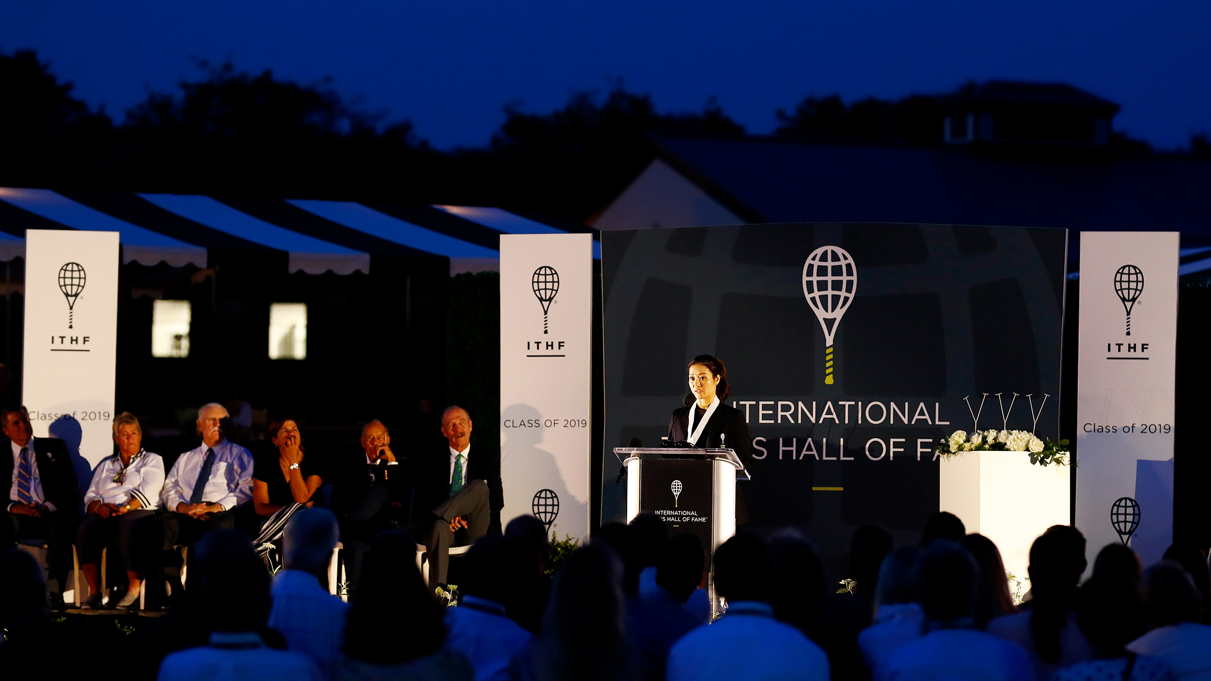 Li Na gives her speech after being inducted into the International Tennis Hall of Fame in Newport, Rhode Island on July 20, 2019.