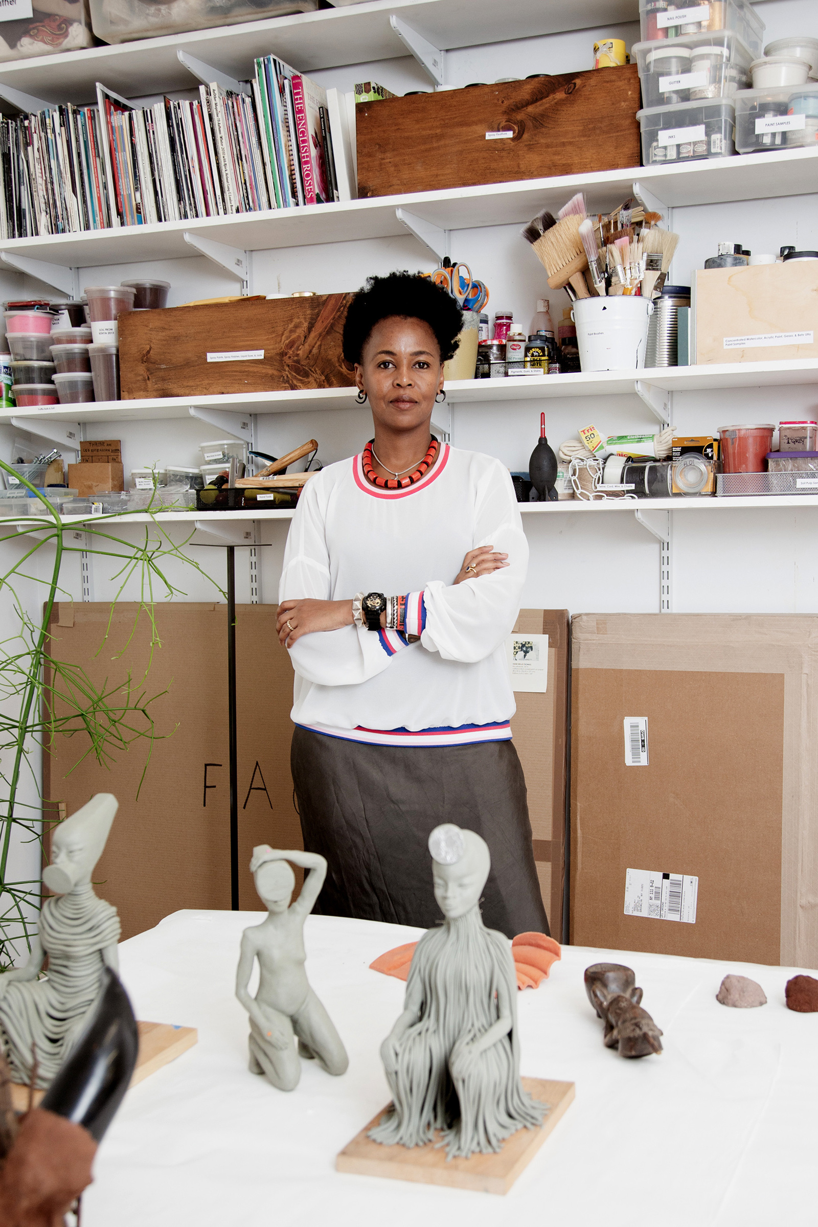 Artist Wangechi Mutu in her Brooklyn studio with models for her sculptures that were installed outside the Metropolitan Museum of Art in New York, Sept. 26, 2019.