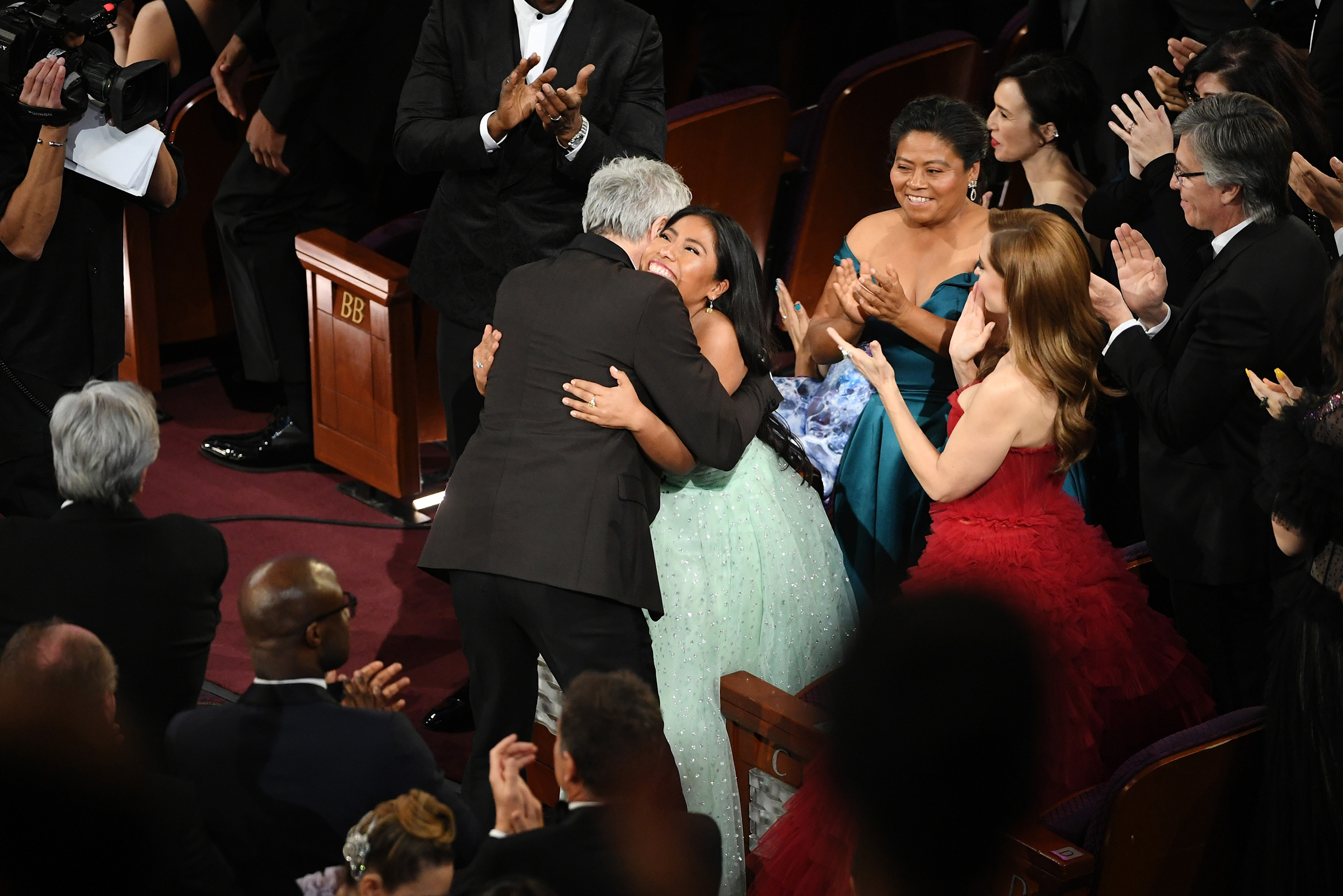 Yalitza Aparicio hugs Alfonso Cuaron after Cuaron won the Cinematography award for 'Roma' during the 91st Annual Academy Awards on Feb. 24, 2019.