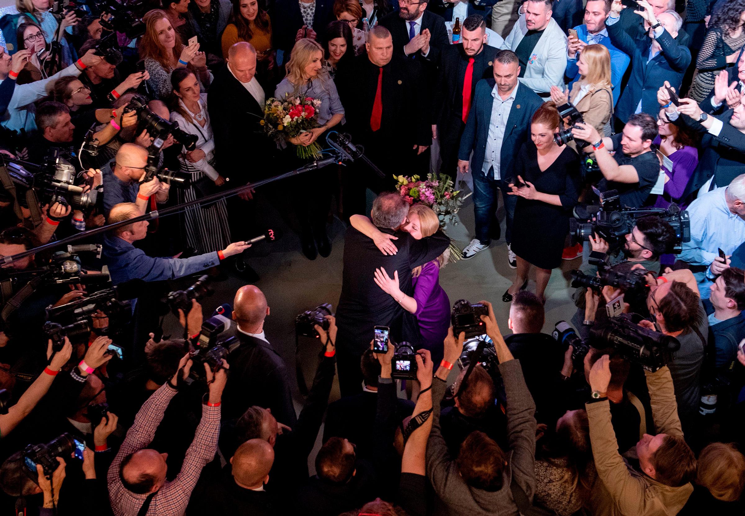 Slovak President Andrej Kiska congratulates Slovakia's President-elect Zuzana Caputova as she wins the election in Bratislava, Slovakia on March 30, 2019.