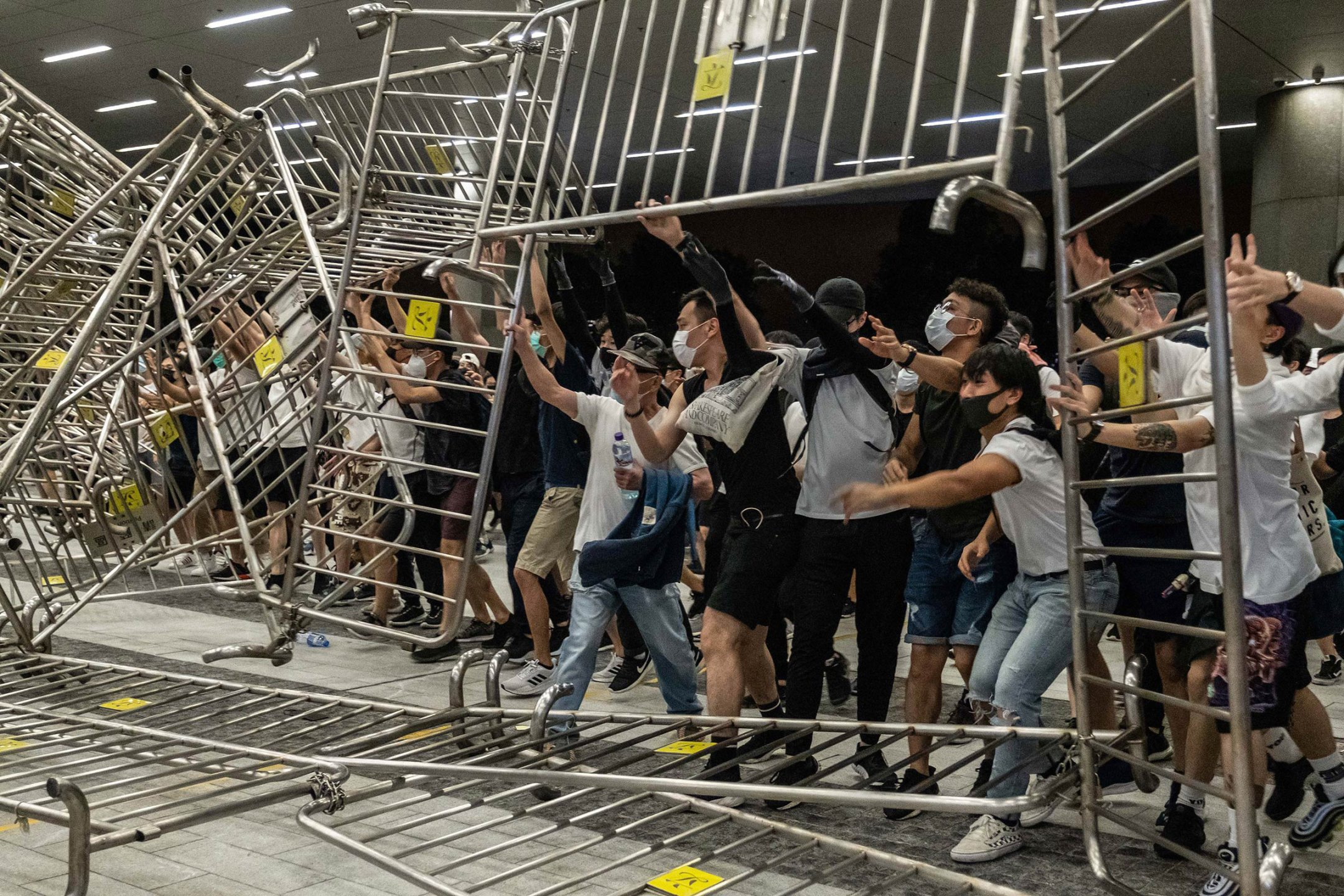 Carrie Lam's proposal to allow extraditions from Hong Kong to mainland China had hardly been announced before the territory's leader felt the head of a frustrated generation. Hundreds of thousands of protesters filled the streets—like these on June 10—then did it the next week, and then the next. At one point they numbered 2 million. The extradition bill did die, but it was too late to stop what it had started: Hong Kong had been transformed, and a new normal had arrived.