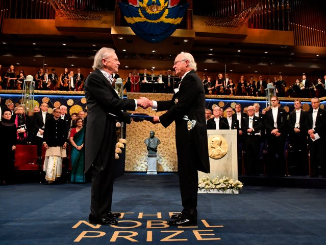 Austrian author Peter Handke, left, receives the 2019 Nobel Prize from King Carl Gustaf of Sweden, during the Nobel Prize award ceremony at the Stockholm Concert Hall, in Stockholm, Tuesday, Dec. 10, 2019.