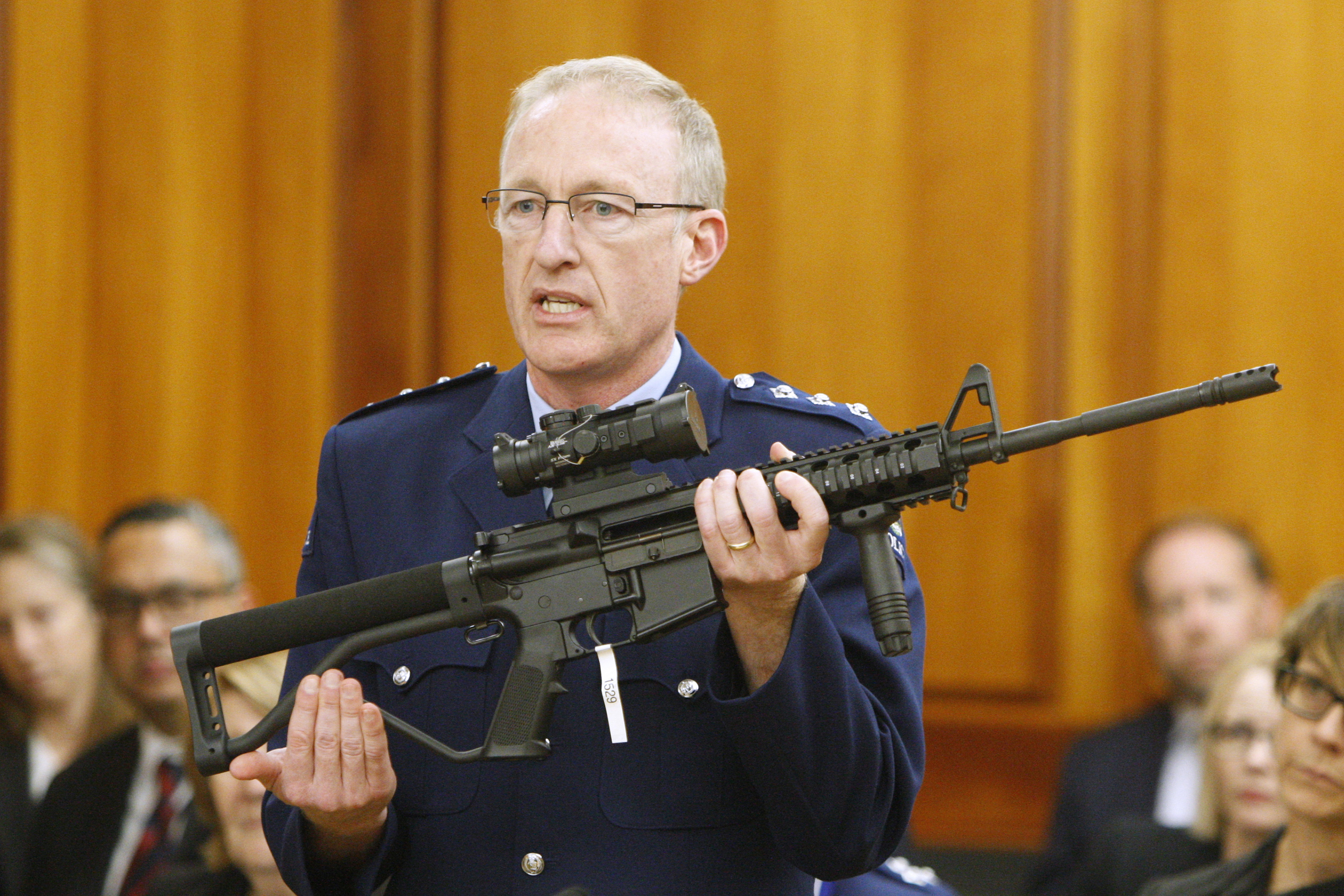 Police acting superintendent Mike McIlraith shows New Zealand lawmakers an AR-15 style rifle similar to one of the weapons a gunman used to slaughter 51 worshippers at two Christchurch mosques, in Wellington, New Zealand, on April 2, 2019.