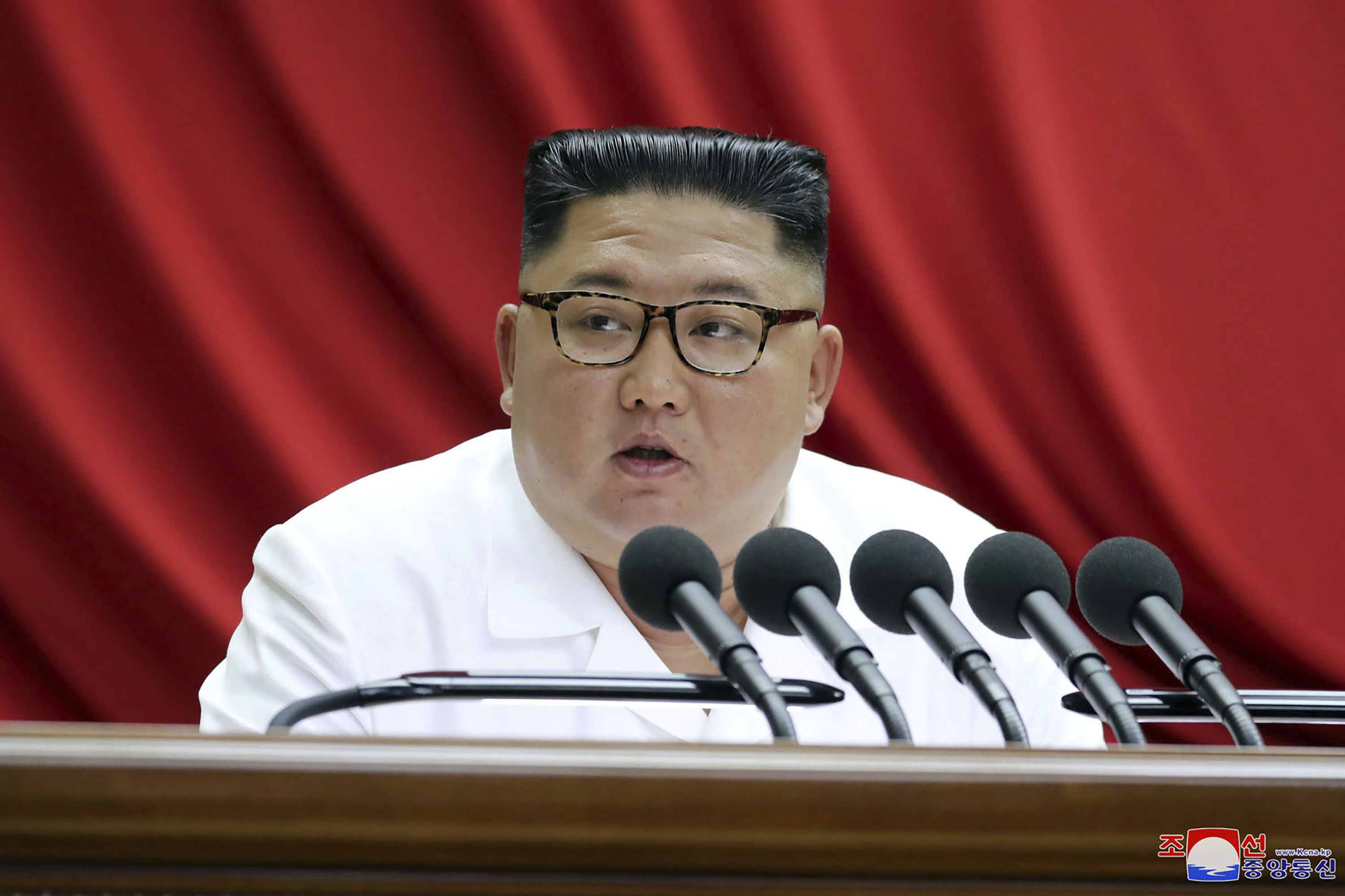 In this Monday, Dec. 30, 2019, photo provided by the North Korean government, North Korean leader Kim Jong Un speaks during a Workers' Party meeting in Pyongyang, North Korea.