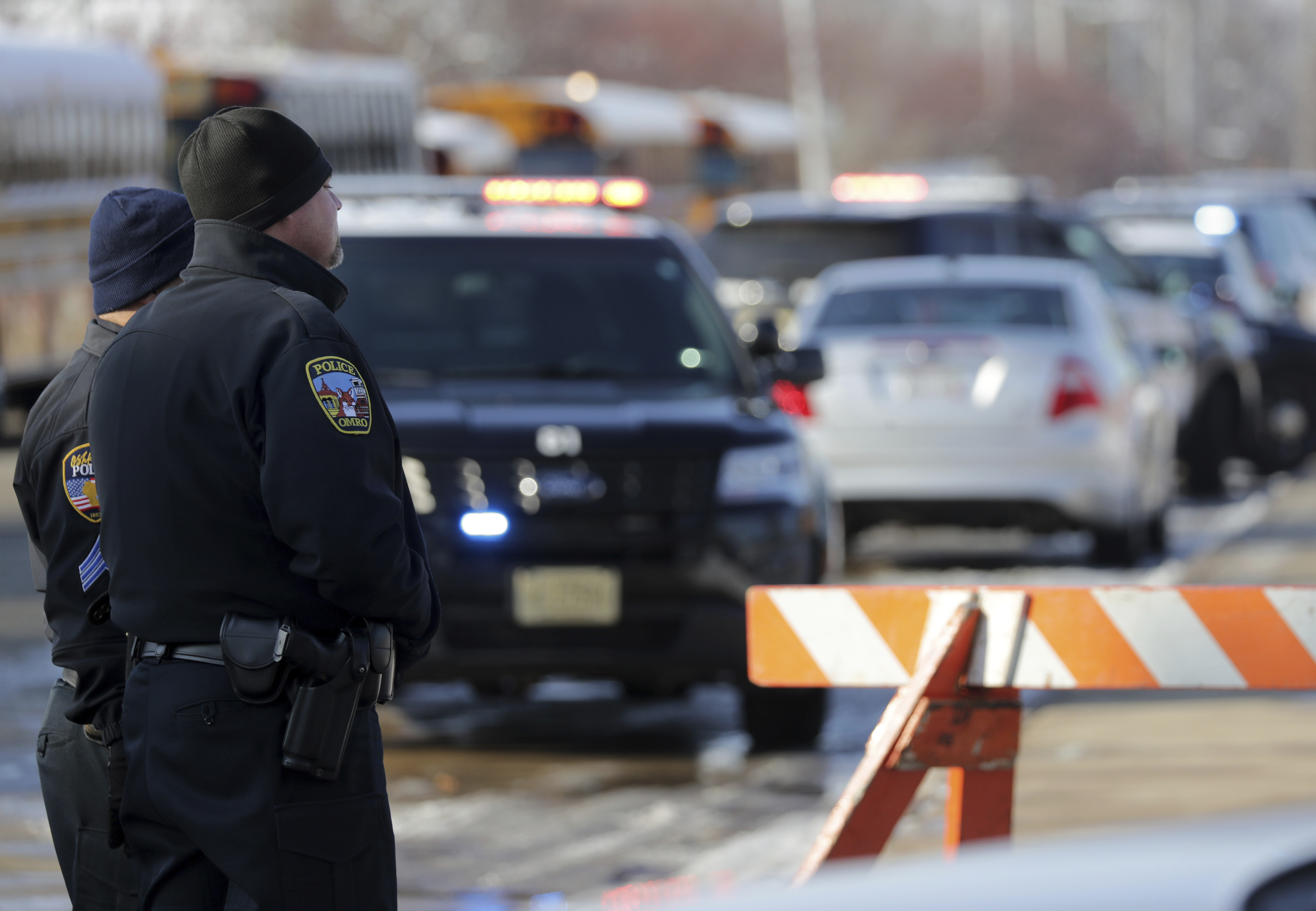Police on the scene on an officer invloved shooting at Oshkosh West High School after an armed student confronted a school resource officer on Tuesday December 3, 2019, at in Oshkosh, Wis. Police in Oshkosh say a police officer and an armed student whom he confronted at the school were both wounded in the confrontation Tuesday morning.