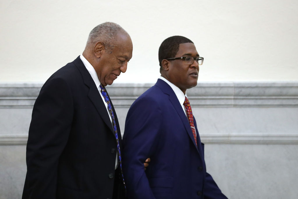 Actor and comedian Bill Cosby is led from the courtroom during a break by his spokesman Andrew Wyatt at the Montgomery County Courthouse, during his sexual assault trial sentencing Sept. 24, 2018 in Norristown, Pennsylvania.