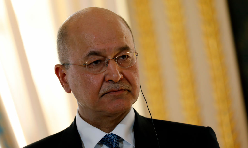 Iraqi President Barham Salih talks at a press conference with French President Emmanuel Macron at the Presidential Palace on February 25, 2019 in Paris, France.
