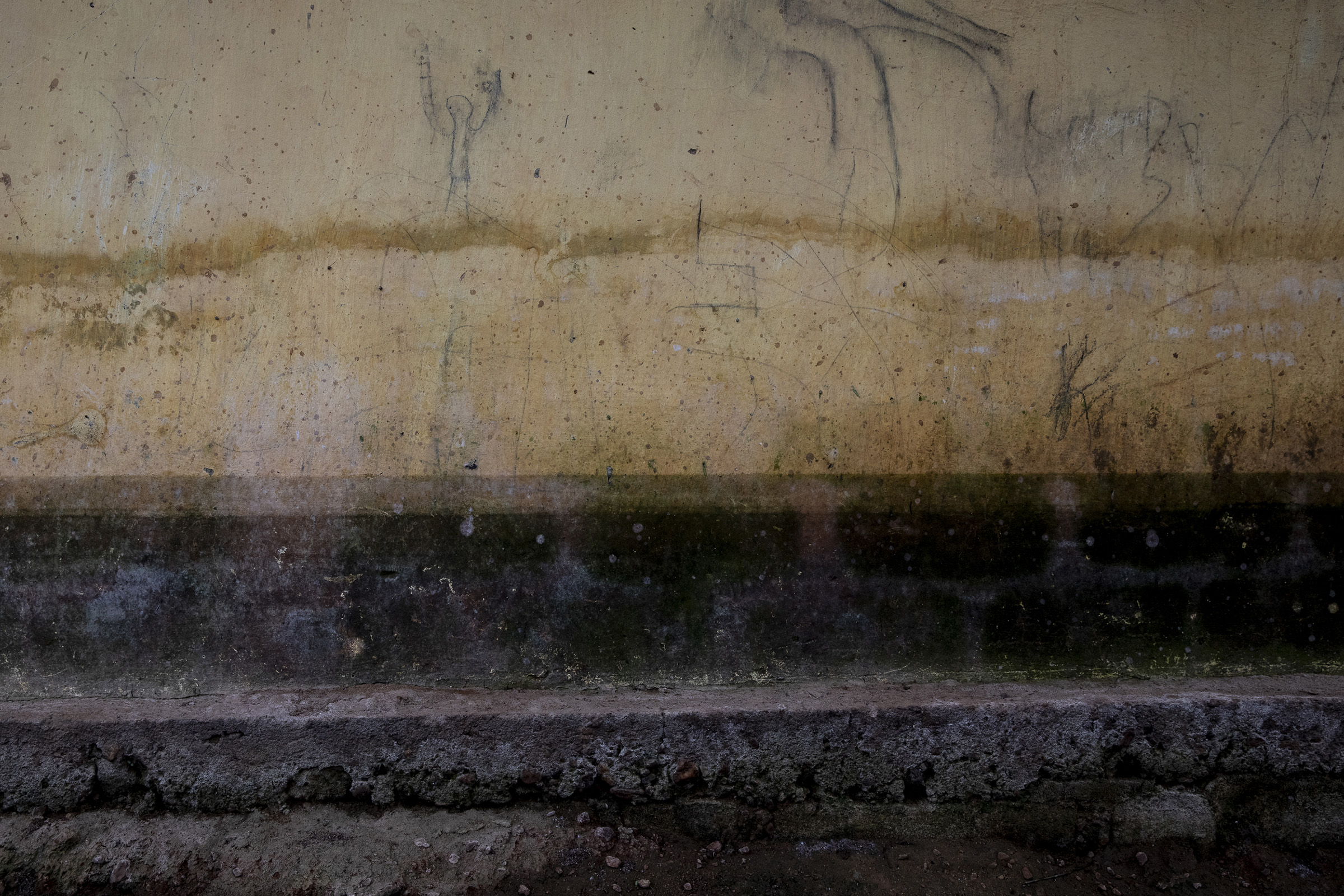 Water marks showing the flooding are seen in Georgine Kouangassam's neighbor's house on Nov.26, 2019. When the water rose in Kouangassam's house at night, everyone struggled to get out in the dark. Her granddaughter Angela, 3, drowned.