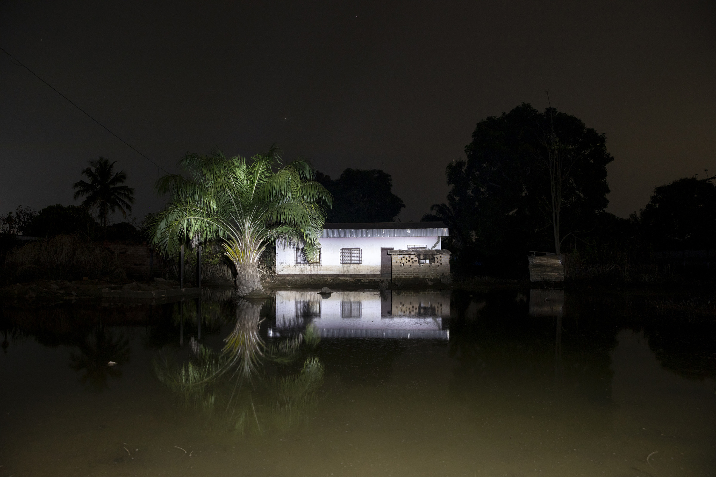 A house is seen at night in a flooded neighbourhood of Bangui, capital of the Central African Republic, on Nov. 22, 2019 during a night patrol.
