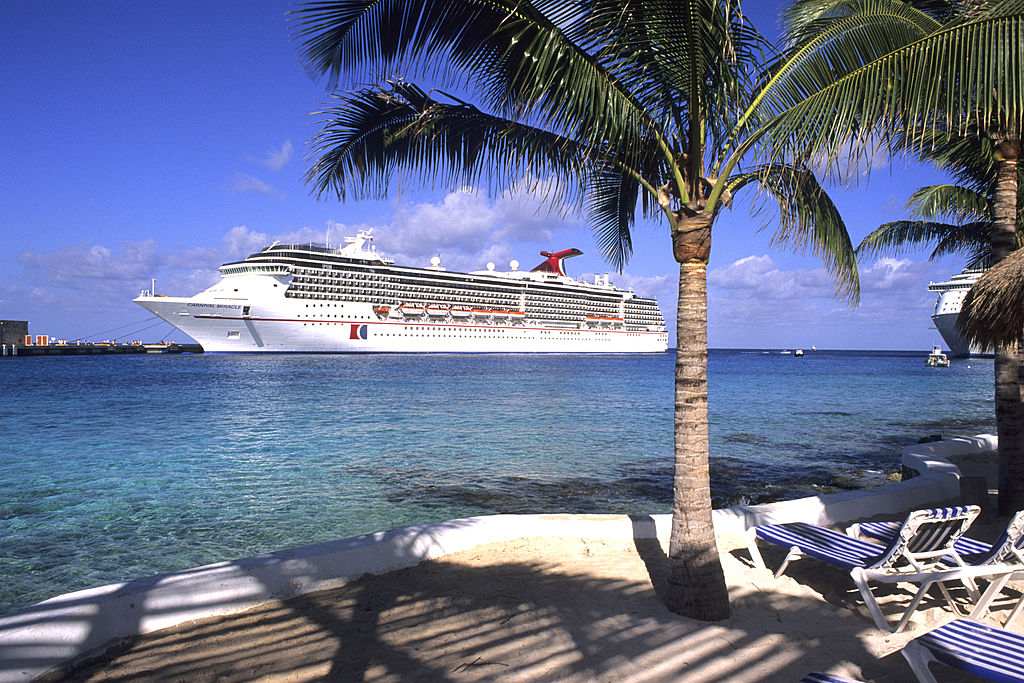 A Carnival Cruise Ship can be seen from a beach in Cozumel, Mexico.
