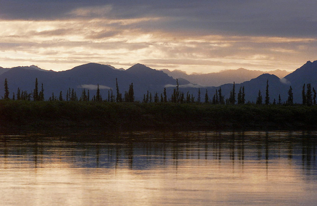 The Chandalar River East Fork and the Brooks Range Mountains (background) at the Artic Village, Alaska, on July 24, 2001. The Gwich'in Indian Tribe live in the Arctic Village settlement and on the Venetie Indian Reserve, south of the Alaska National Wildlife Reserve.