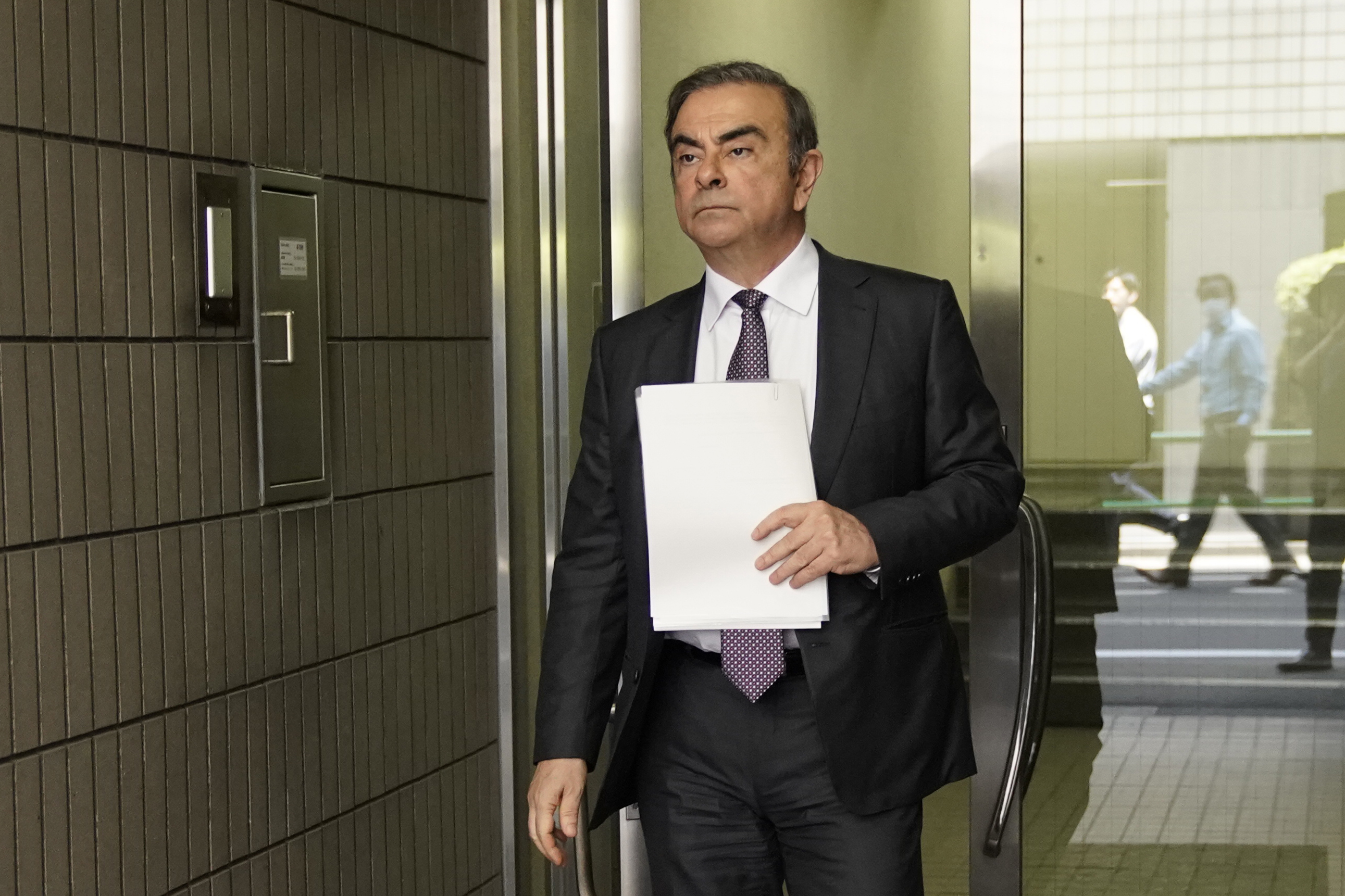 Carlos Ghosn, former chairman of Nissan Motor Co., leaves his lawyer's office in Tokyo, Japan, on Thursday, May 23, 2019.