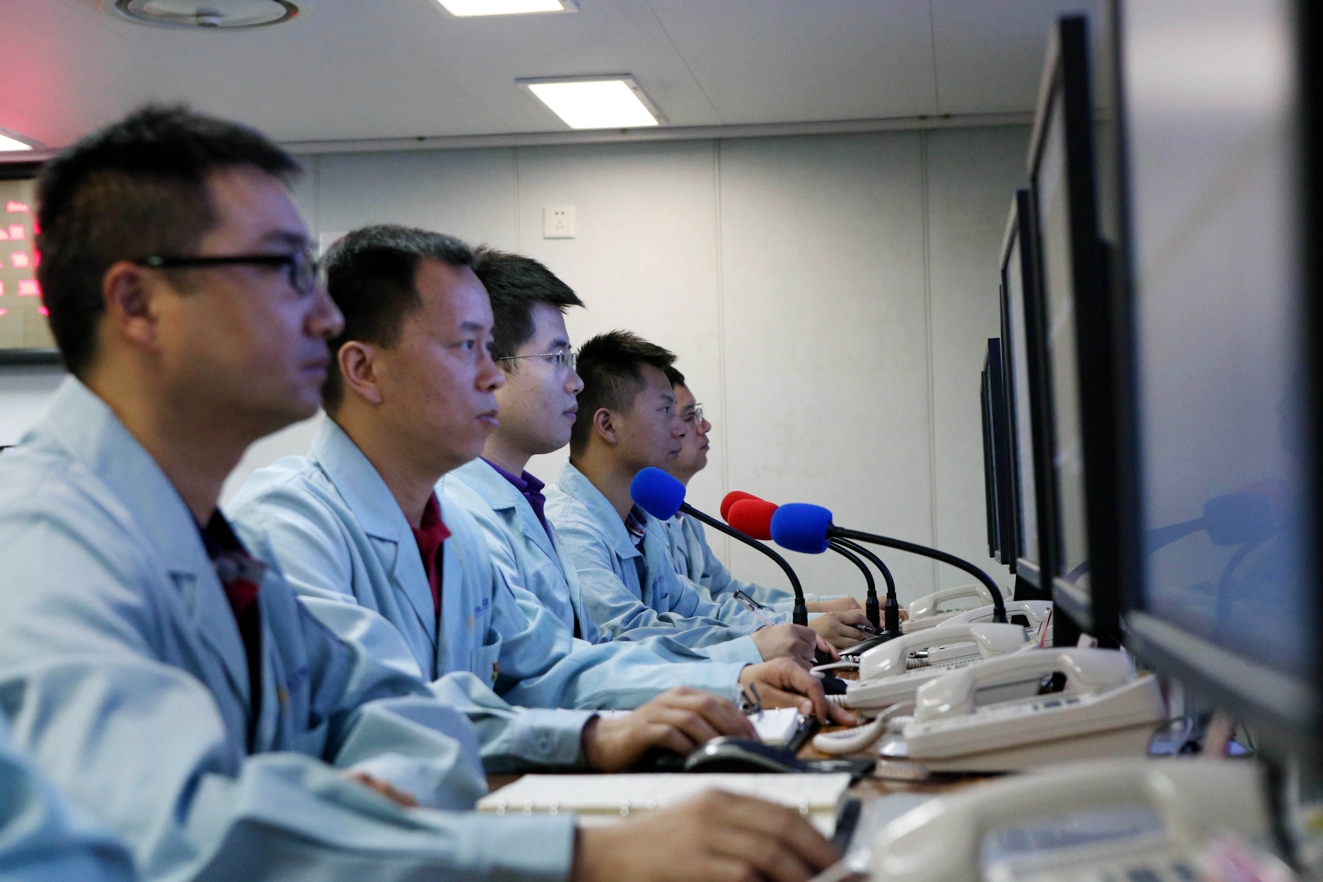 Staff members work during a maritime monitoring mission of a satellite launch on China's spacecraft tracking ship Yuanwang-3, June 25, 2019, after China sent a satellite of the Beidou Navigation Satellite System into space.