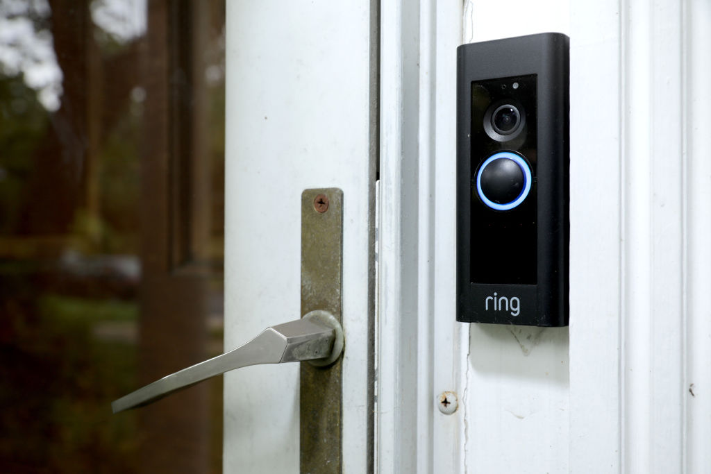A doorbell device with a built-in camera made by home security company Ring is seen on August 28, 2019 in Silver Spring, Maryland. These devices allow users to see video footage of who is at their front door when the bell is pressed or when motion activates the camera. According to reports, Ring has made video-sharing partnerships with more than 400 police forces across the United States, granting them access to camera footage with the homeowners' permission in what the company calls the nation's 'new neighborhood watch.'