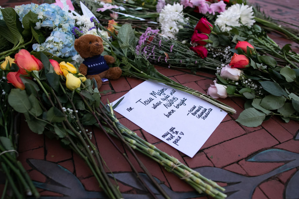 Flowers are laid near the entrance of Barnard College on December 12, 2019 in New York City.