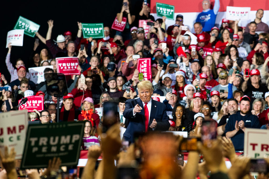 President Donald Trump greets supporters as he enters the stage during a rally at Kellogg Arena in Battle Creek, Mich., on Dec. 18, 2019.