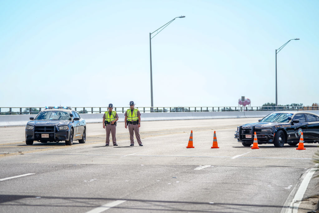 Florida State Troopers block traffic over the Bayou Grande Bridge leading to the Pensacola Naval Air Station following a shooting on Dec. 06, 2019 in Pensacola, Florida. The second shooting on a U.S. Naval Base in a week has left three dead plus the suspect and seven people wounded.