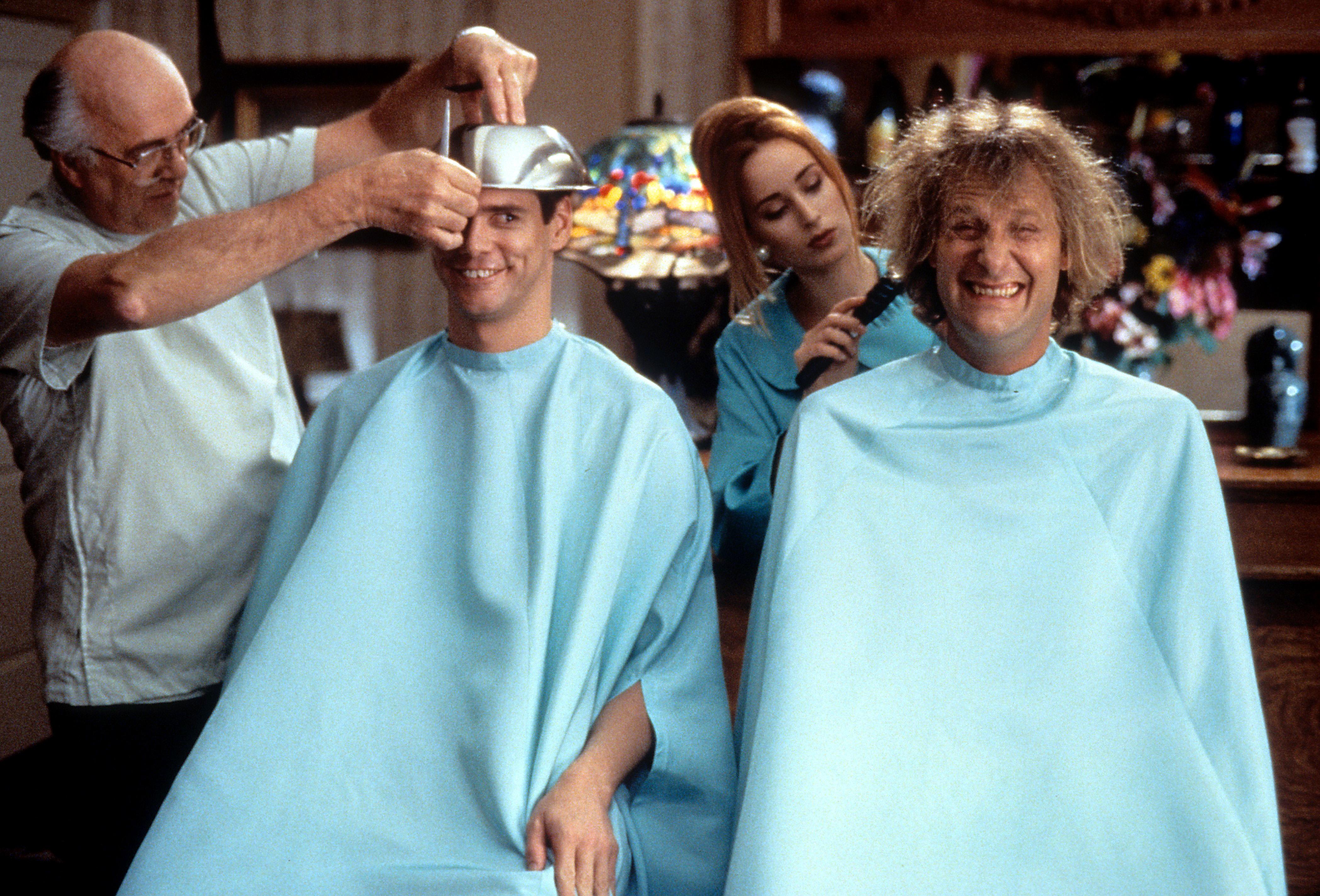 Jim Carrey and Jeff Daniels getting their hair cut in 'Dumb & Dumber', 1994.