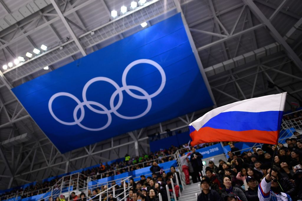 A spectator waves the Russia flag during the 2018 Winter Olympic Games in Pyeongchang, where Russians competed as individuals not as part of a national team, on February 16, 2018.