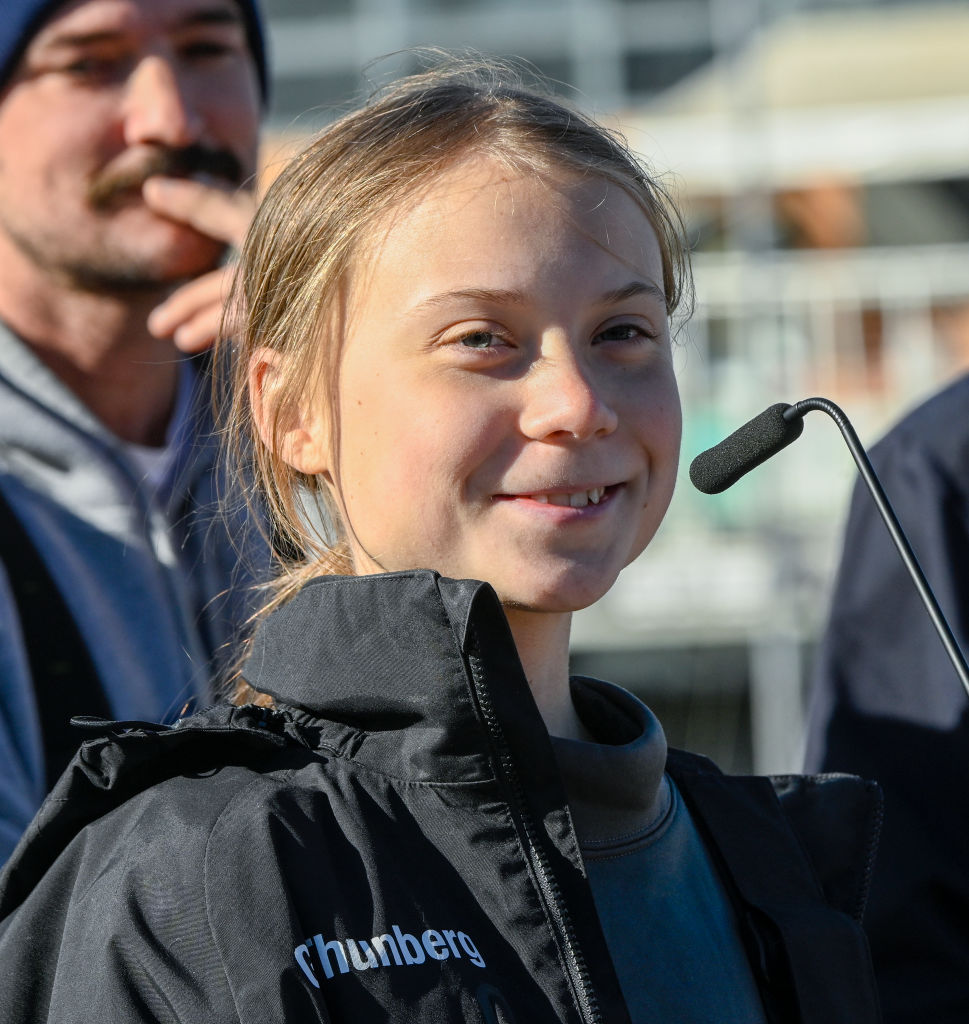 Swedish teen climate activist Greta Thunberg addresses supporters and journalists upon her arrival in Santo Amaro Recreation dock on December 03, 2019 in Lisbon, Portugal. Greta Thunberg sailed from Norfolk, Virginia, USA , accompanied by her father Svante Thunberg on the French built Outremer 45 catamaran La Vagabonde, skippered by Australian Riley Whitelum, and is on her way to attend COP25 in Madrid, Spain.