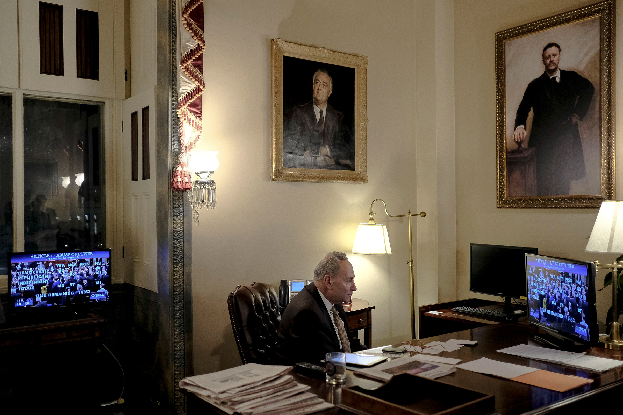 Senate Minority Leader Sen. Chuck Schumer of N.Y., watches the House vote on articles of impeachment in his office at the Capitol in Washington, D.C. on Dec. 18, 2019.