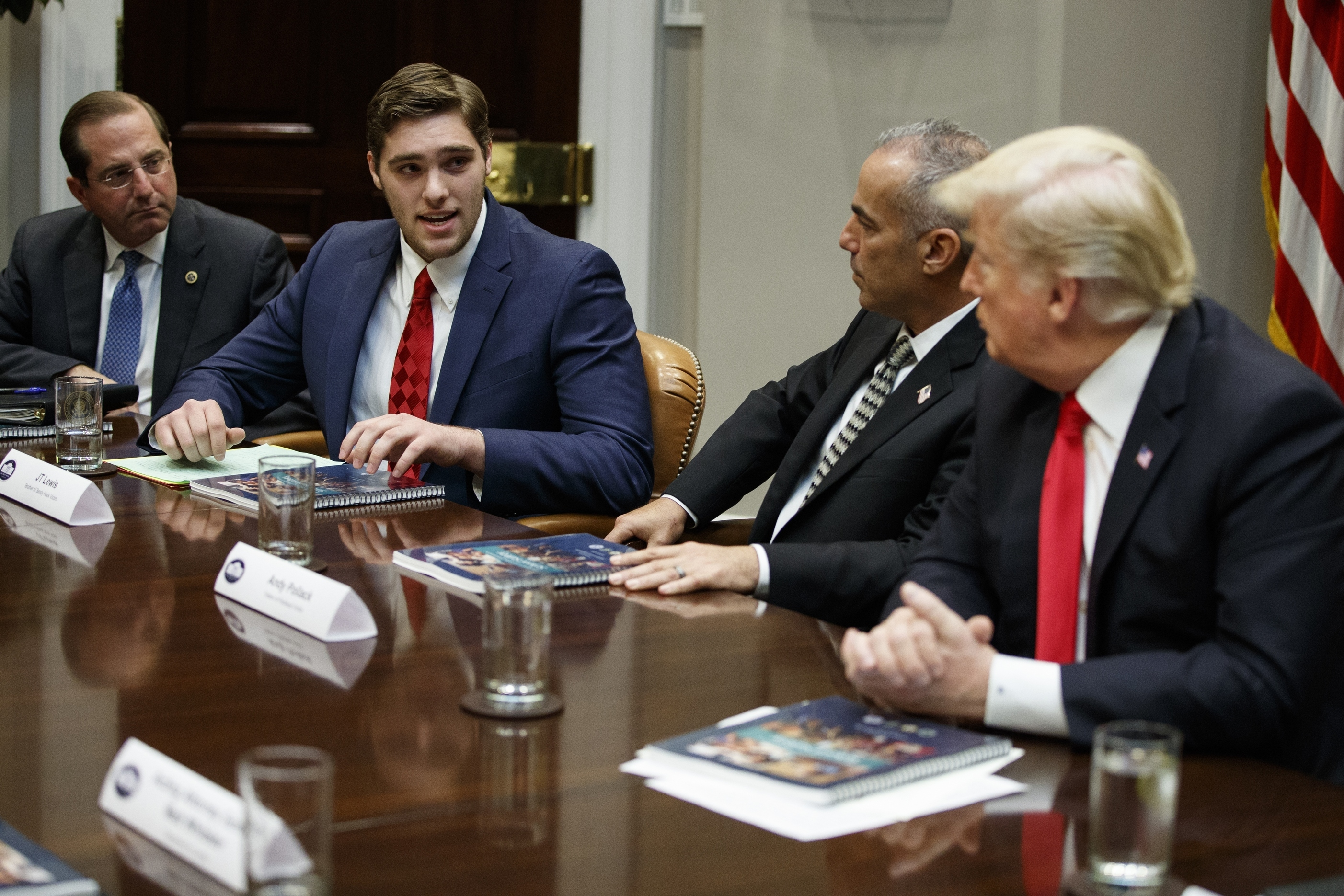 J.T. Lewis, brother of Sandy Hook victim Jesse Lewis, speaks to President Donald Trump and others during a roundtable discussion on the Federal Commission on School Safety report, in the Roosevelt Room of the White House in Washington on Dec. 18, 2018.